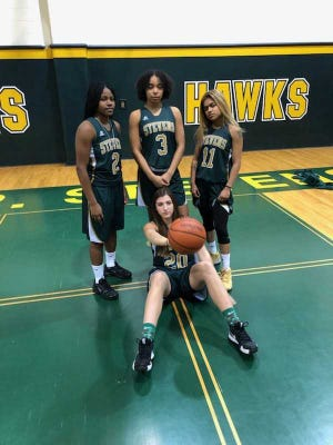 J.P. Stevens girls basketball captains (back row) Kiarah Turner, Kayla Gatling, Disha Prabhudesai (front) Megan Duffy