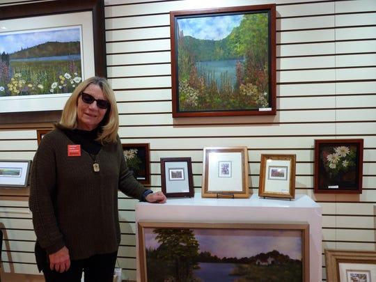 "Kathleen Maguire Morolda at her Princeton shop, Cranbury Station Gallery wearing a ""racism hurts everyone"" pin."