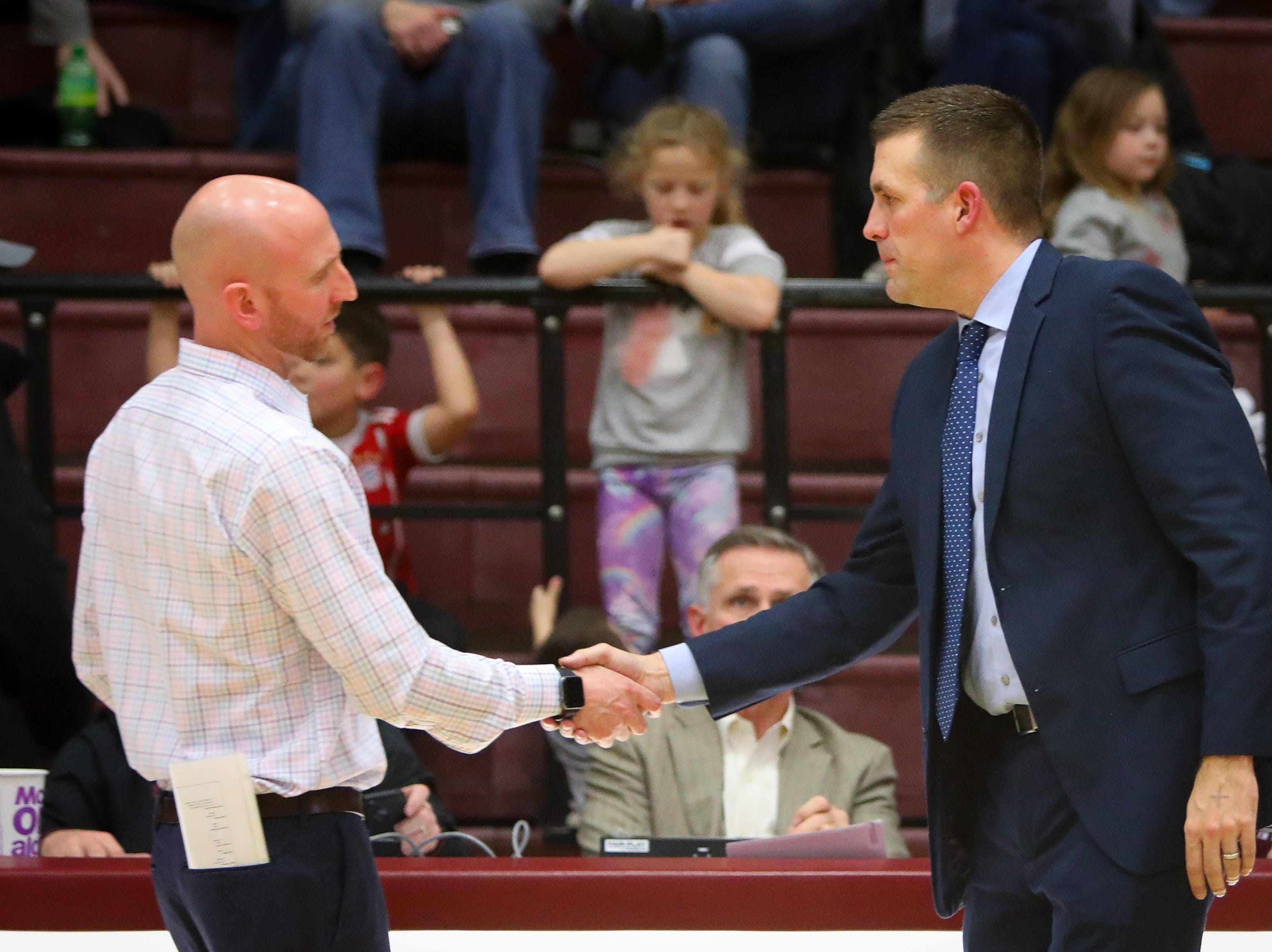 Dowling head coach Mike O'Connor (left) and Urbandale head coach Jon Schmitz shake hands after the Maroons defeated the J-Hawks, 42-35, in a boys high school basketball game at Dowling Catholic High School on Jan. 11, 2019 in West Des Moines, Iowa.