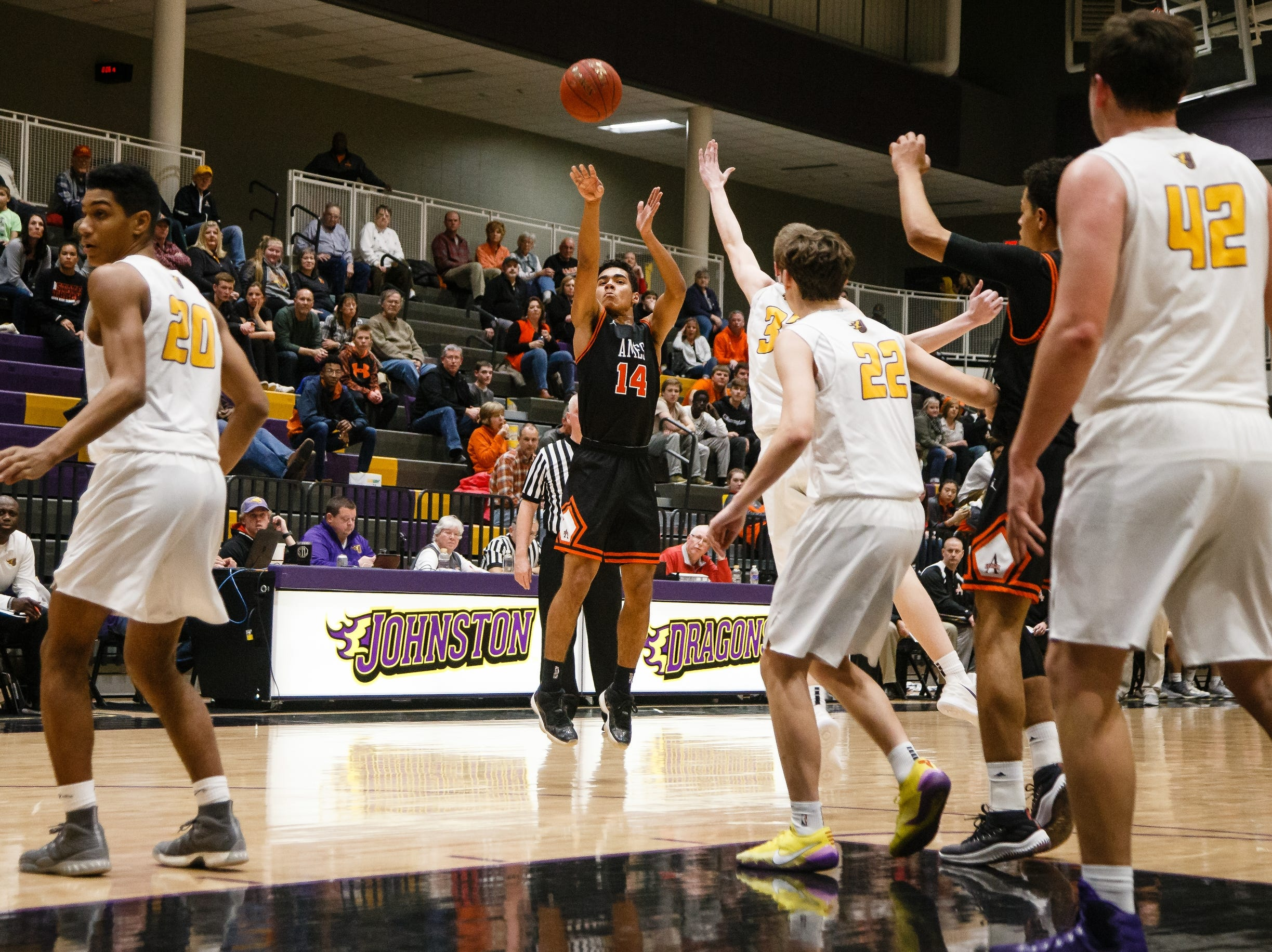 Ames freshman Tamin Lipsey hits a three point shot during Ames' basketball game against Johnston on Friday, Jan. 11, 2019, in Johnston.