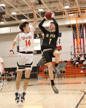 Southeast Polk's James Glenn puts up a shot over Valley's Jake Auer during a Jan. 11 game. Glenn averaged 10.2 points per game and shot 46% from deep as a sophomore.