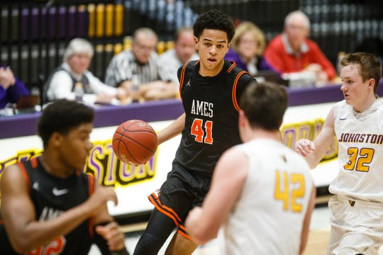 Ames senior Japannah Kellogg drives to the net during Ames' basketball game against Johnston on Friday, Jan. 11, 2019, in Johnston.