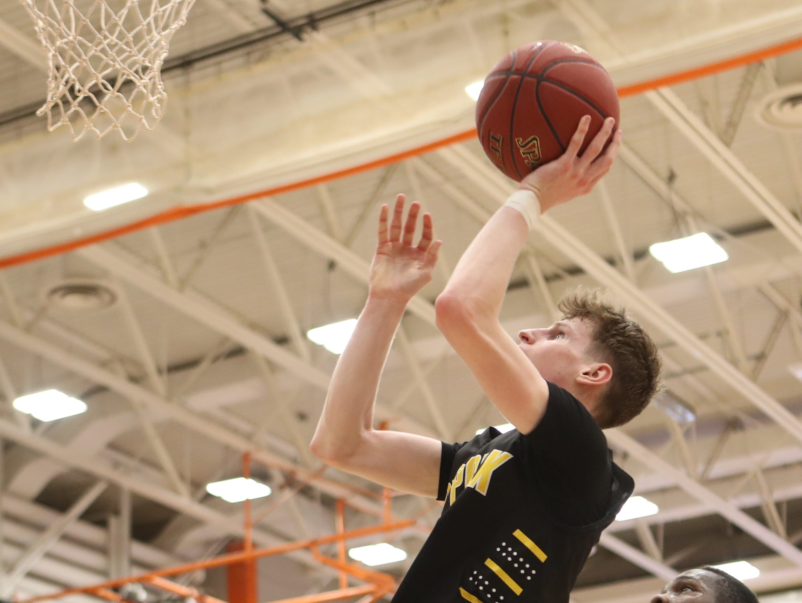Southeast Polk Rams' Sam Glenn (11) shoots and scores against the Valley Tigers during a boys basketball game at Valley High School on Jan. 11, 2019. Valley won, 61-54.