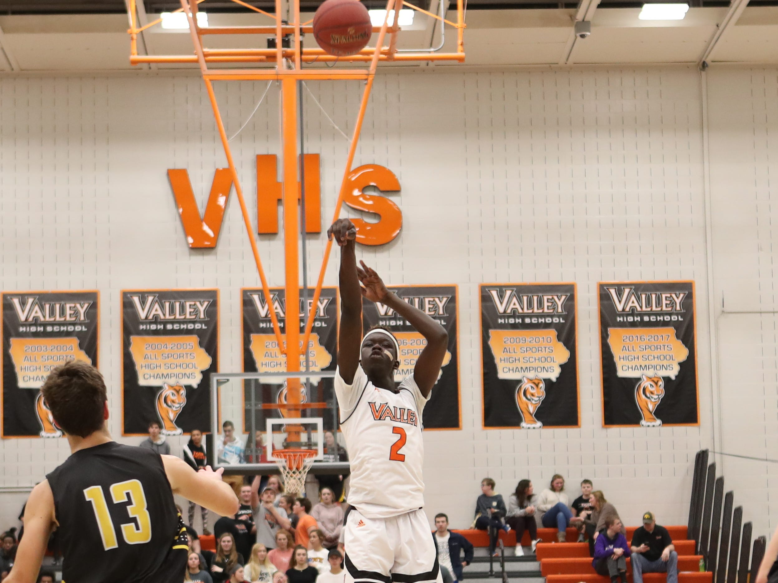 Valley Tigers' Aguek Deng (2) shoots against the Southeast Polk Rams during a boys basketball game at Valley High School on Jan. 11, 2019.