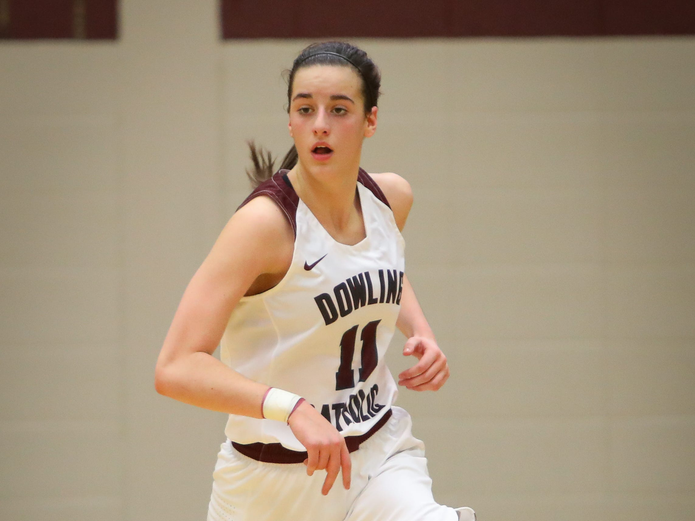 Dowling junior Caitlin Clark brings the ball up the court during a girls high school basketball game between the Urbandale J-Hawks and the Dowling Catholic Maroons at Dowling Catholic High School on Jan. 11, 2019 in West Des Moines, Iowa. Clark went on to score 46 points in the game.