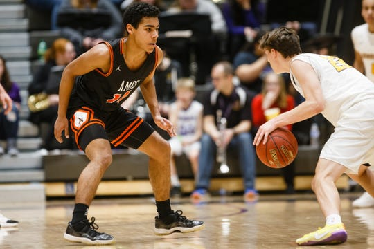 Ames freshman Tamin Lipsey defends Johnston's Reid Grant during Ames' basketball game against Johnston on Friday, Jan. 11, 2019, in Johnston.