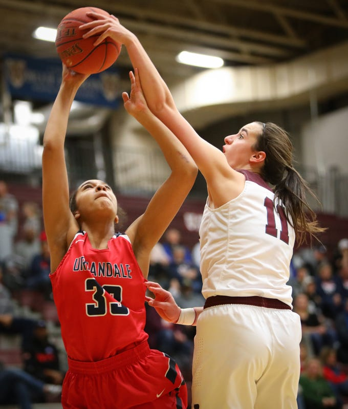 Dowling junior Caitlin Clark blocks a shot from Urbandale sophomore Loraine Koua during a girls high school basketball game between the Urbandale J-Hawks and the Dowling Catholic Maroons at Dowling Catholic High School on Jan. 11, 2019 in West Des Moines, Iowa.