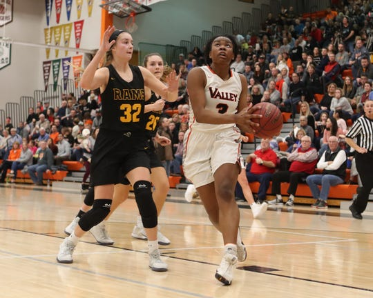 Valley Tigers' Zoe Young scores against the Southeast Polk Rams during a girls basketball game at Valley High School on Jan. 11, 2019.