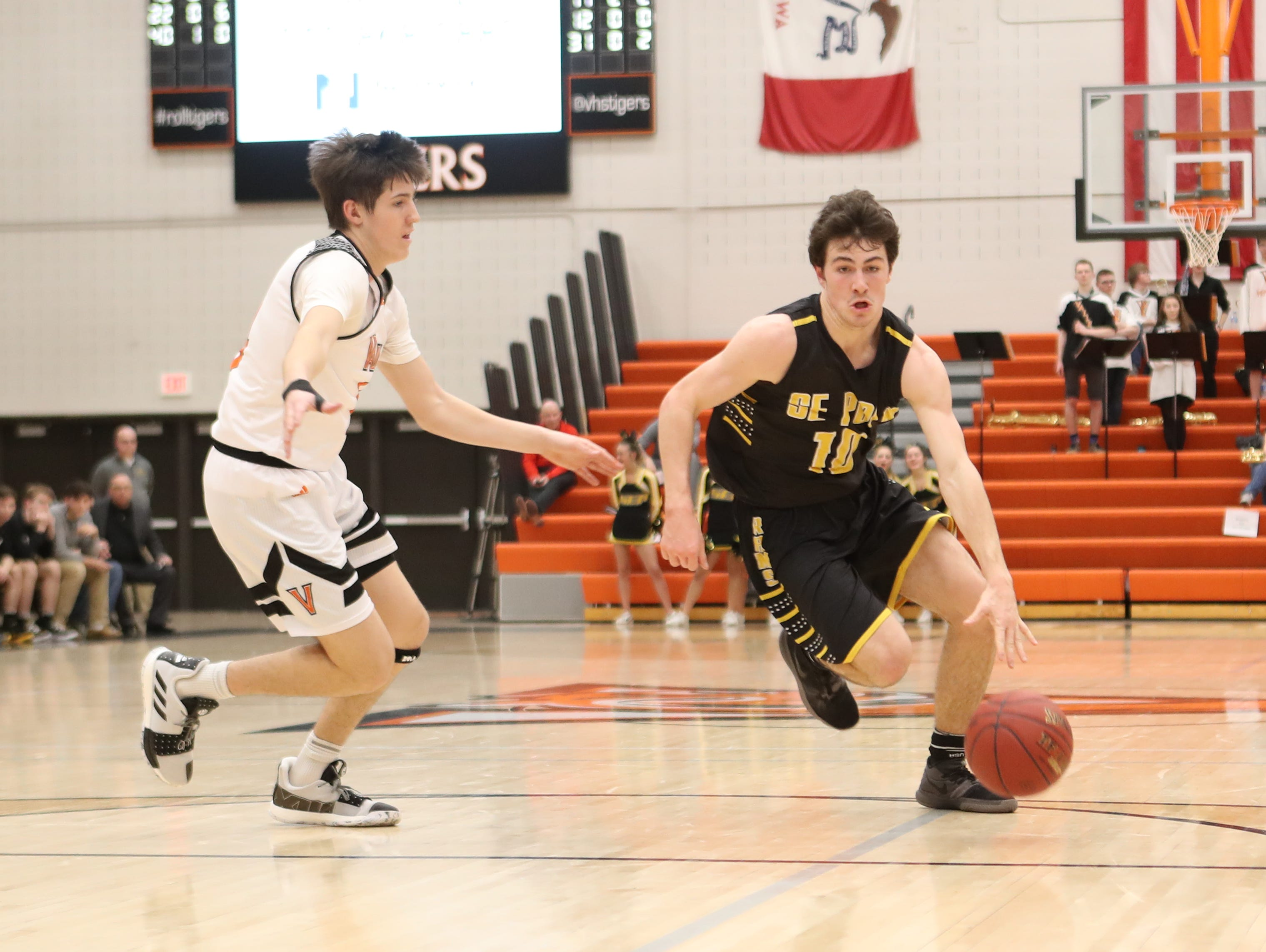 Southeast Polk Rams' Daniel Hackbarth (10) drives to the basket against the Valley Tigers during a boys basketball game at Valley High School on Jan. 11, 2019.