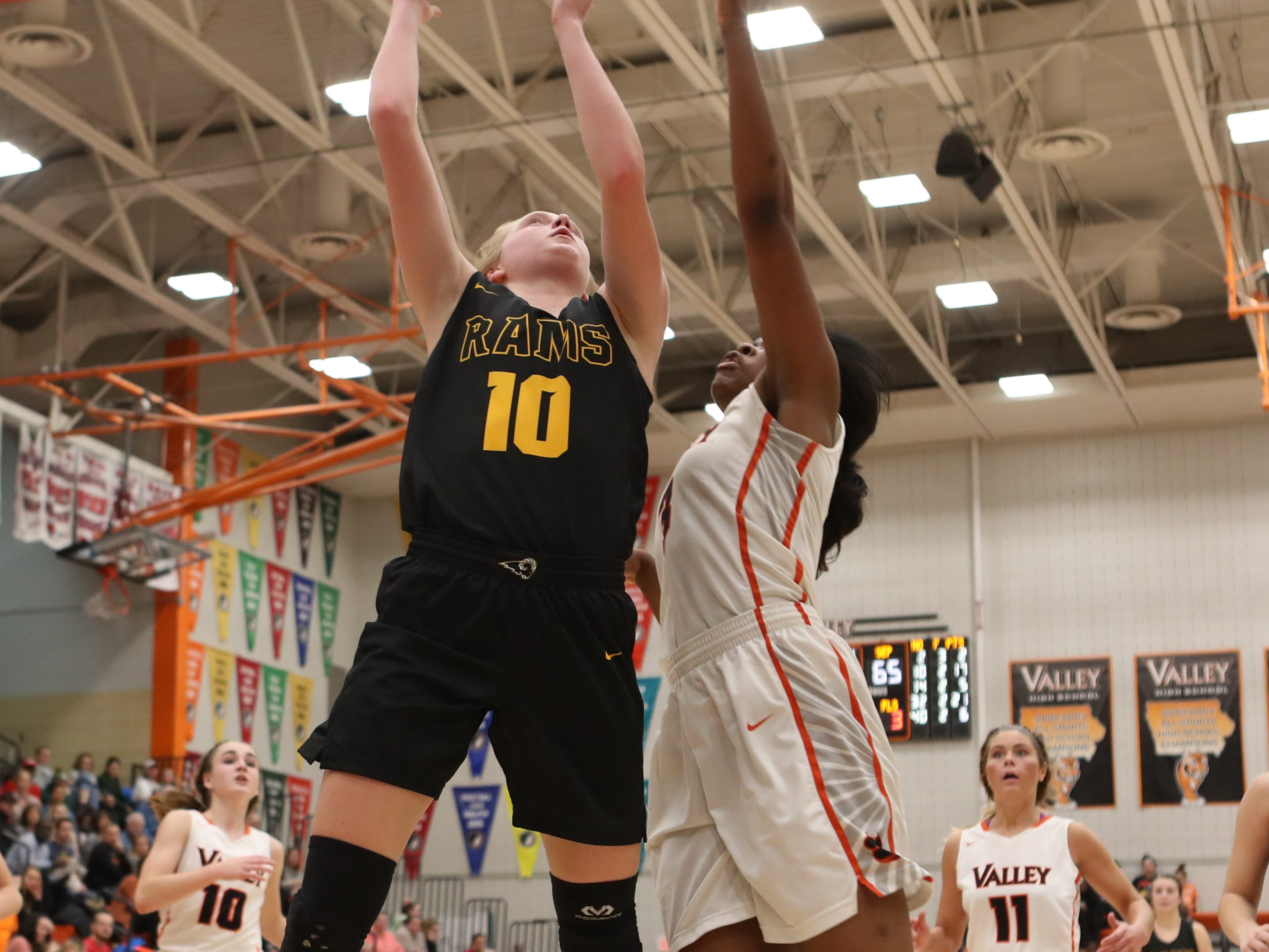 Southeast Polk Rams' Grace Larkins  shoots over the top of Valley Tigers' Zoe Young during a girls basketball game at Valley High School on Jan. 11, 2019.
