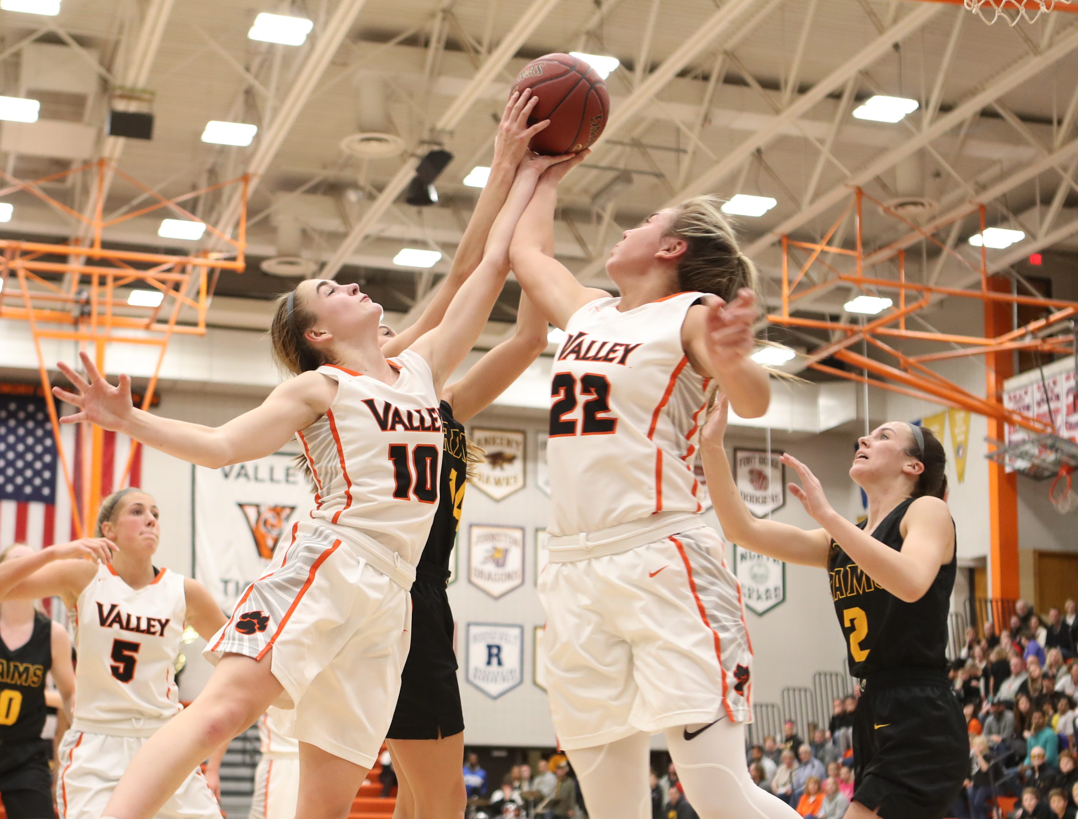 Valley Tigers' Hayley Chappell (10) and Alex Honnold (22) battle Southeast Polk Rams Jessica Stuart (14) for the rebound during a girls basketball game at Valley High School on Jan. 11, 2019. The Rams won, 91-72.