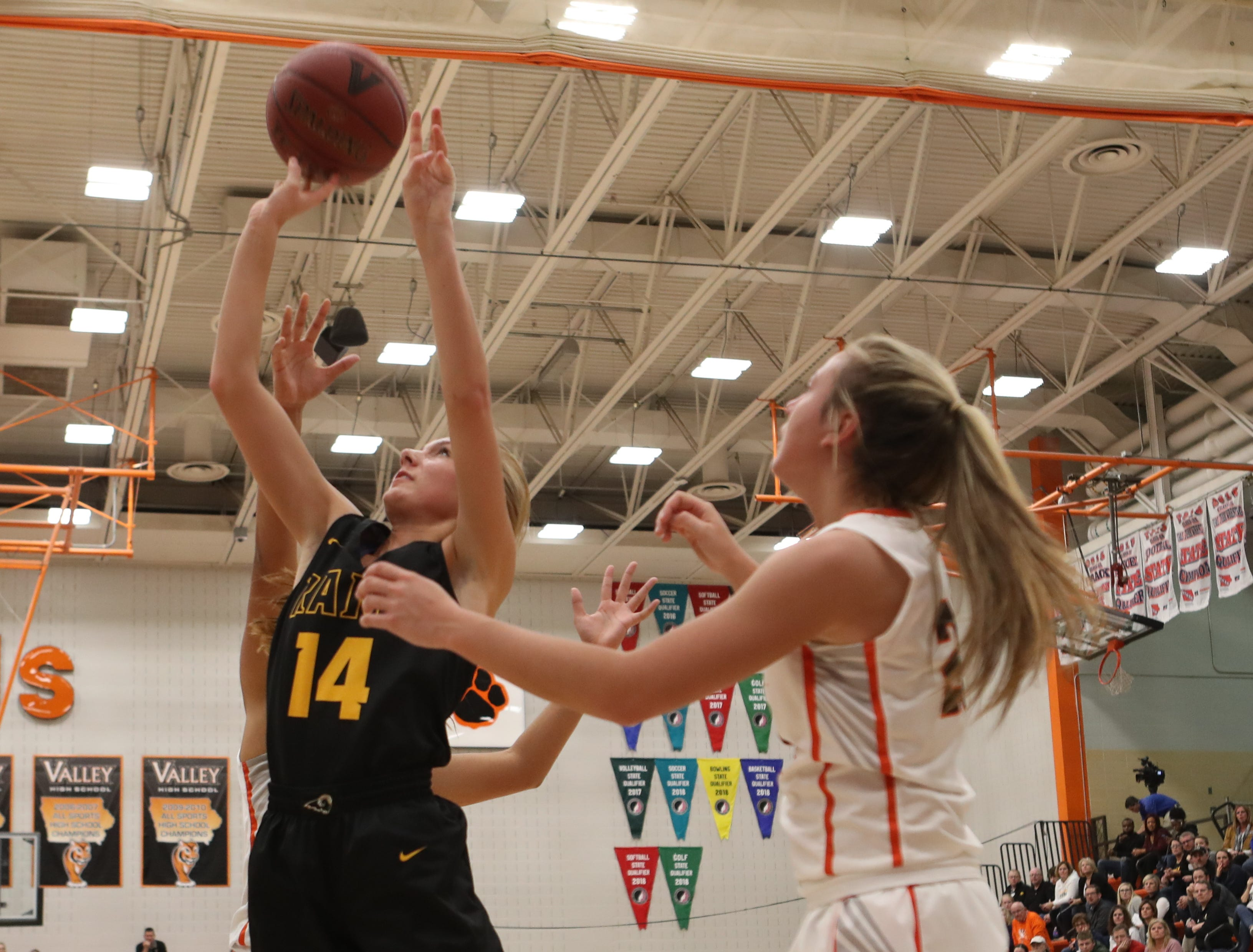 Southeast Polk Rams' Jessica Stuart (14) shoots against the Valley Tigers during a girls basketball game at Valley High School on Jan. 11, 2019.