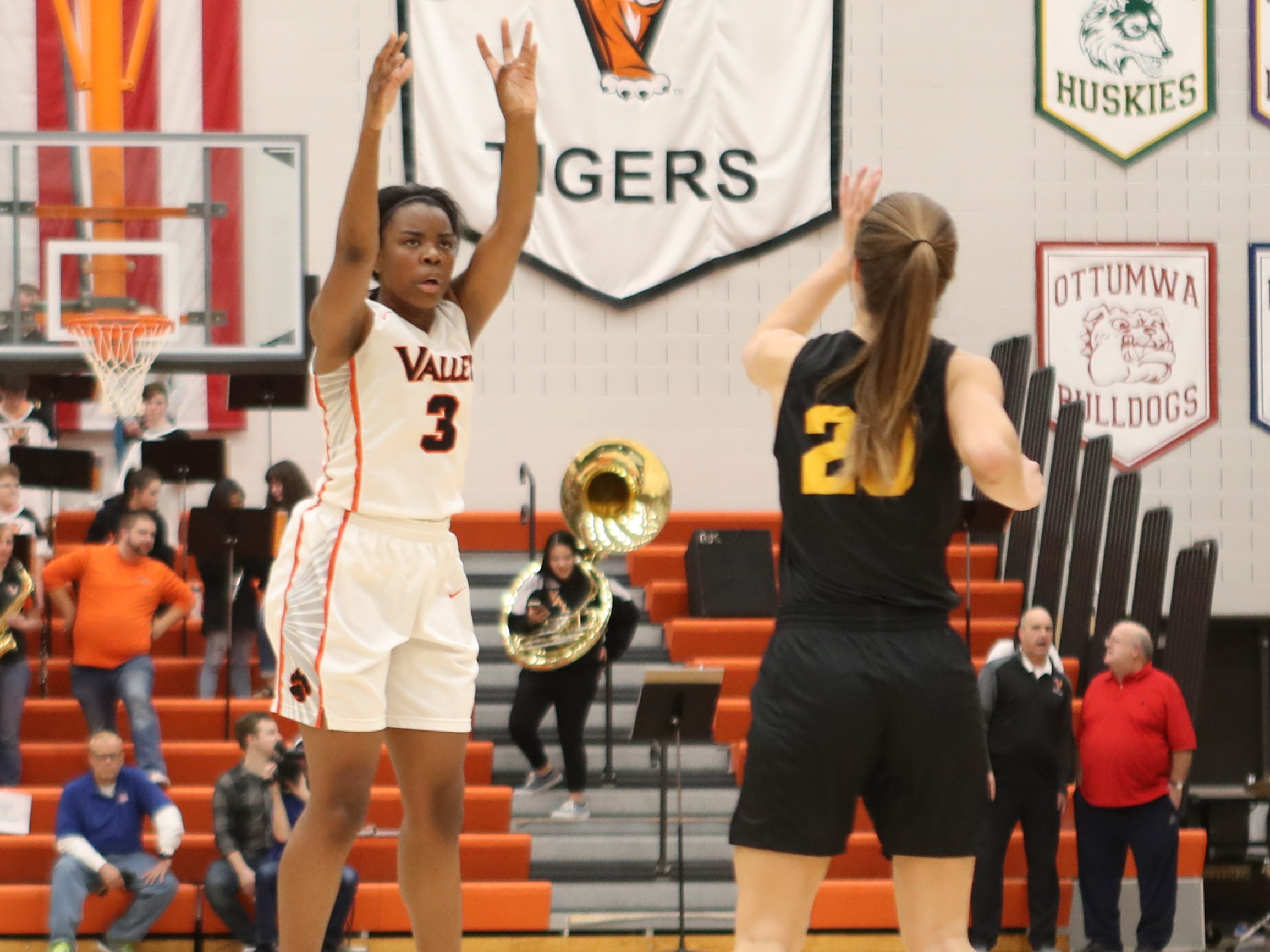 Valley Tigers' Zoe Young scores 3 of her 37 points against the Southeast Polk Rams during a girls basketball game at Valley High School on Jan. 11, 2019. The Rams won, 91-72.