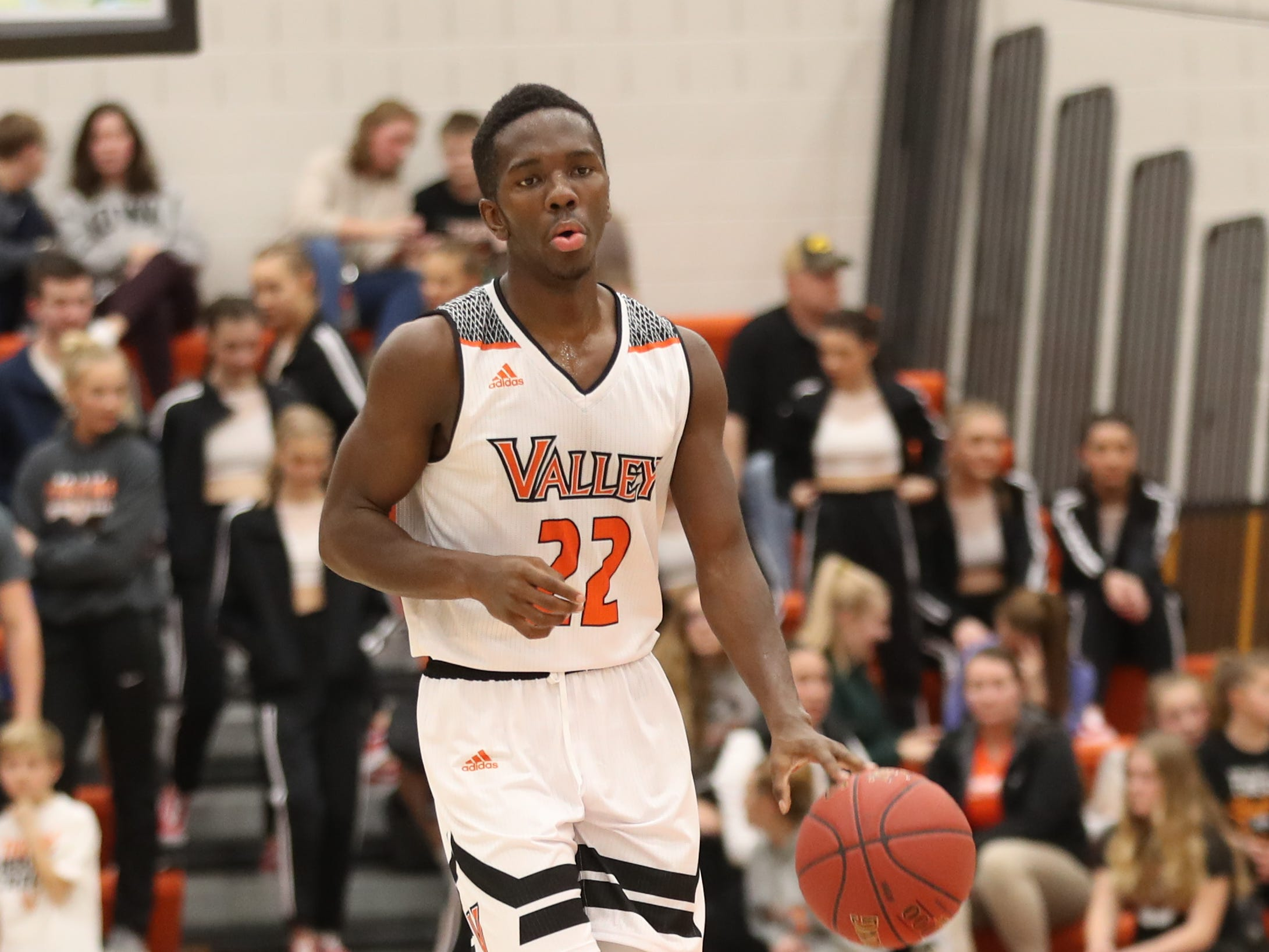 Valley Tigers' Trayvon Williams (22) sets the offense against the Southeast Polk Rams during a boys basketball game at Valley High School on Jan. 11, 2019. Valley won, 61-54.