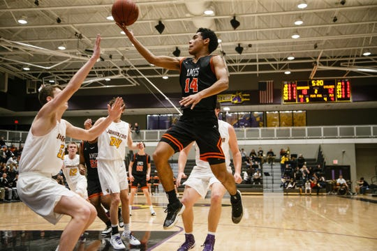 Ames freshman Tamin Lipsey drives to the net during Ames' basketball game against Johnston on Friday, Jan. 11, 2019, in Johnston.