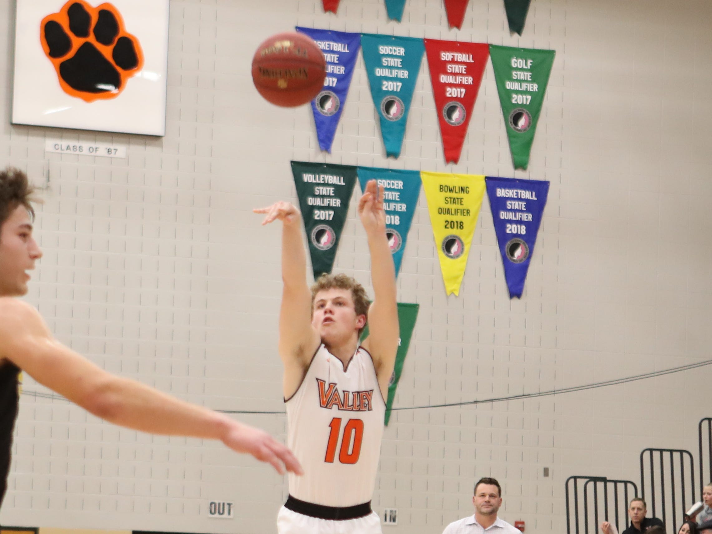 Valley Tigers' Sam Stevens (10) shoots against the Southeast Polk Rams during a boys basketball game at Valley High School on Jan. 11, 2019.