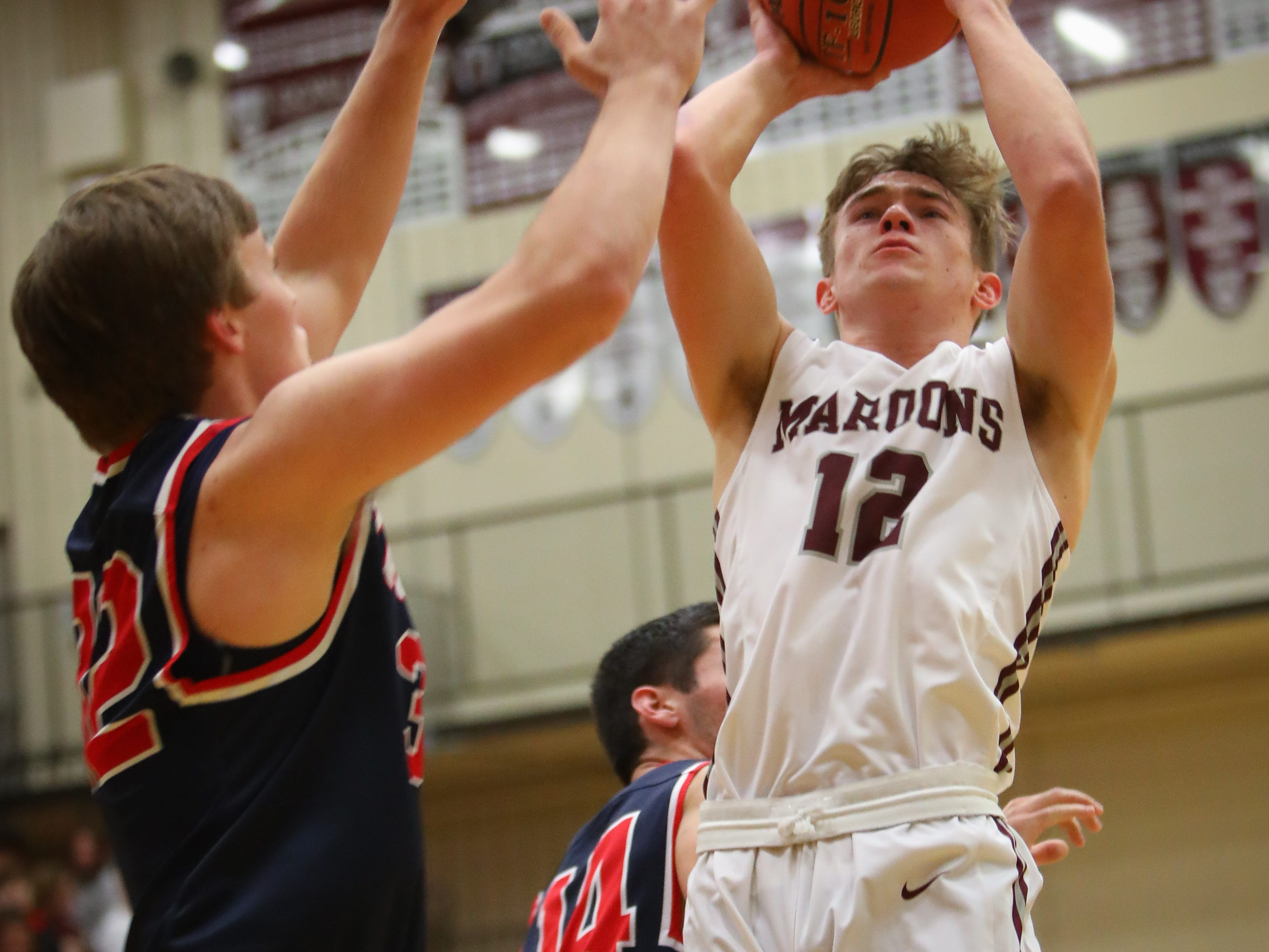 Dowling senior Jack Lyman attempts a jump shot during a boys high school basketball game between the Urbandale J-Hawks and the Dowling Catholic Maroons at Dowling Catholic High School on Jan. 11, 2019 in West Des Moines, Iowa.