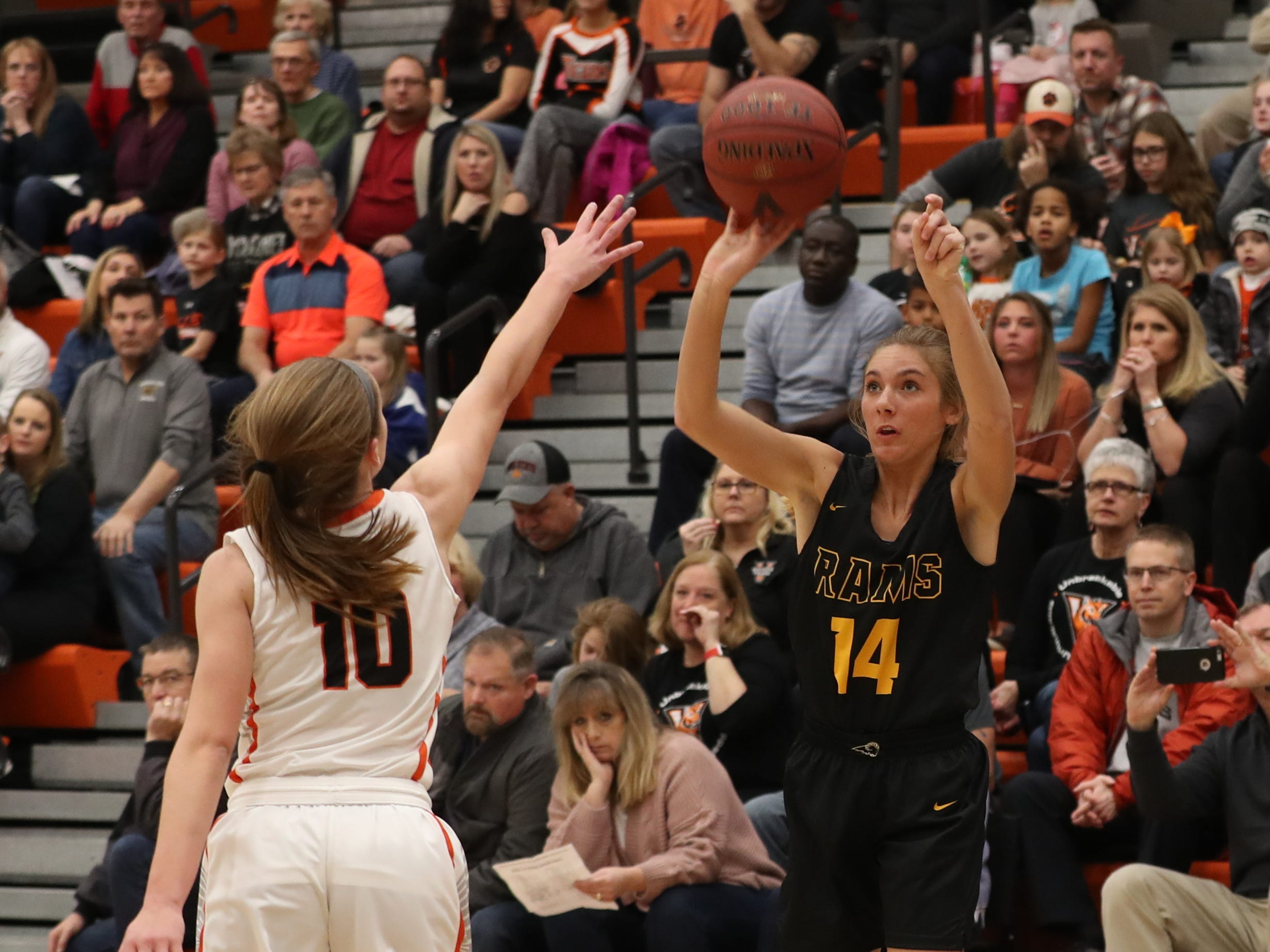 Southeast Polk Rams' Jessica Stuart (14) shoots over Valley Tigers' Hayley Chappell during a girls basketball game at Valley High School on Jan. 11, 2019.