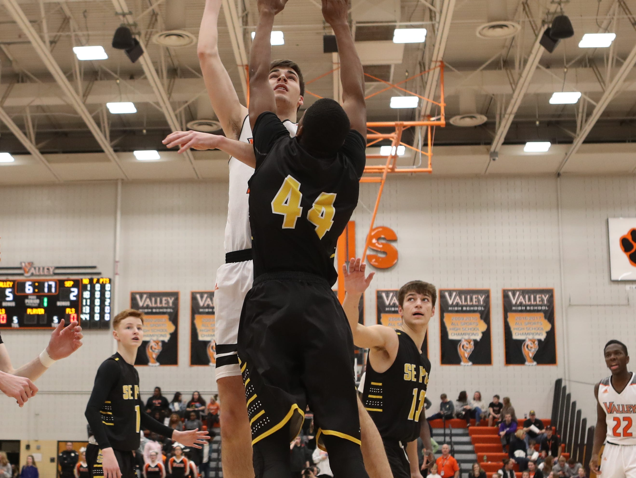 Valley Tigers' Will Berg (32) shoots over the top of Southeast Polk Rams' Malichai Williams (44) during a boys basketball game at Valley High School on Jan. 11, 2019.