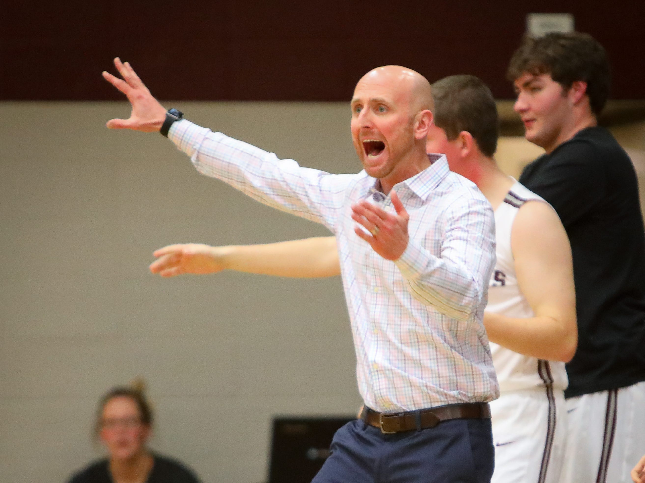 Dowling head coach Mike O'Connor reacts after a play during a boys high school basketball game between the Urbandale J-Hawks and the Dowling Catholic Maroons at Dowling Catholic High School on Jan. 11, 2019 in West Des Moines, Iowa.