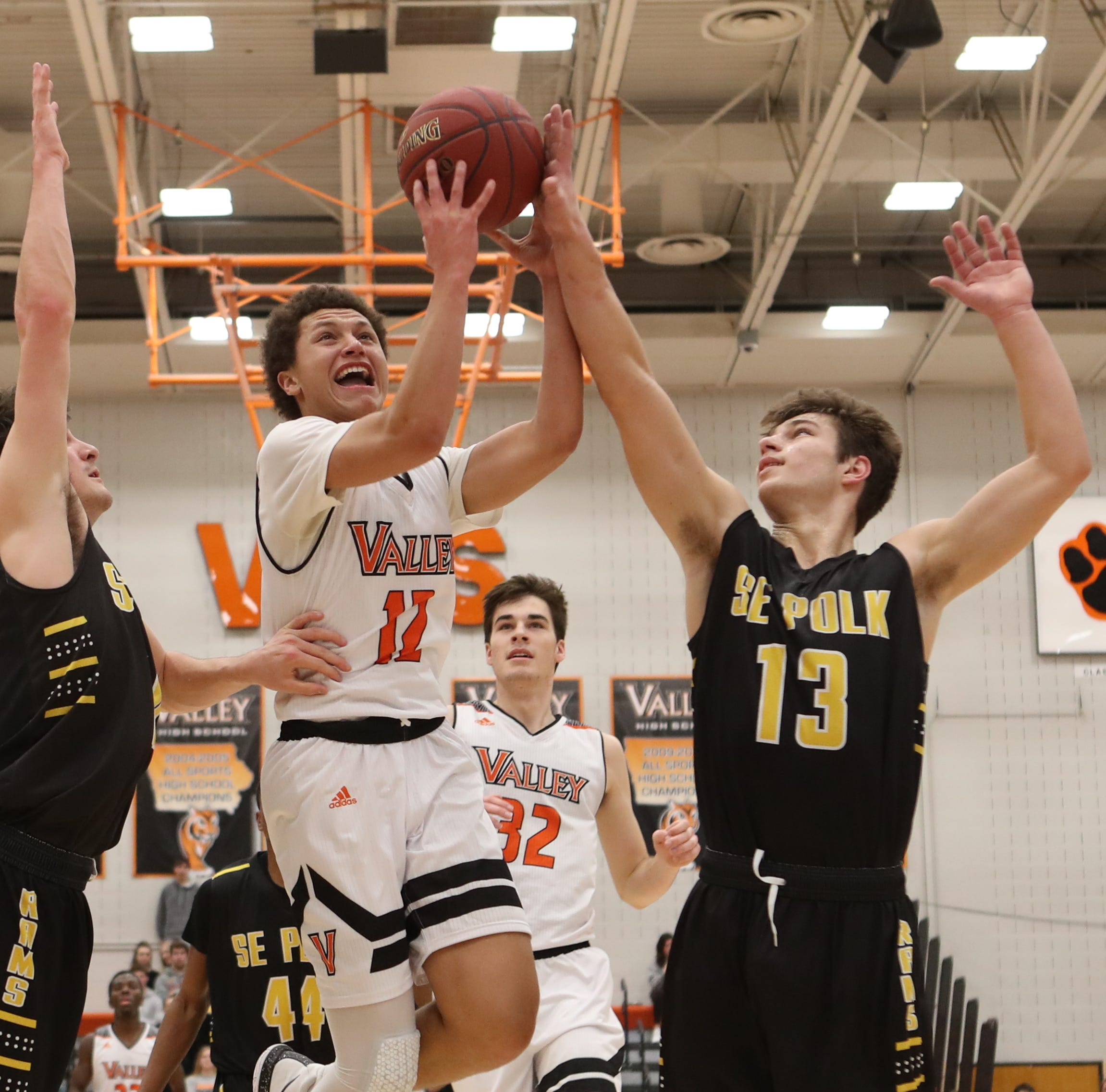 Southeast Polk Rams' Dominic Caggiano (13) blocks...