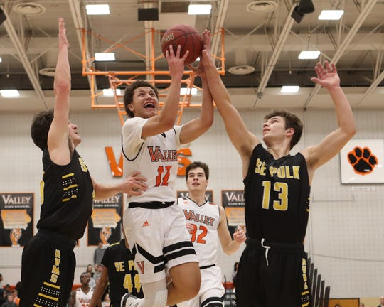 Southeast Polk Rams' Dominic Caggiano (13) blocks the shot from Valley Tigers' Evan Obia (12) during a boys basketball game at Valley High School on Jan. 11, 2019. r