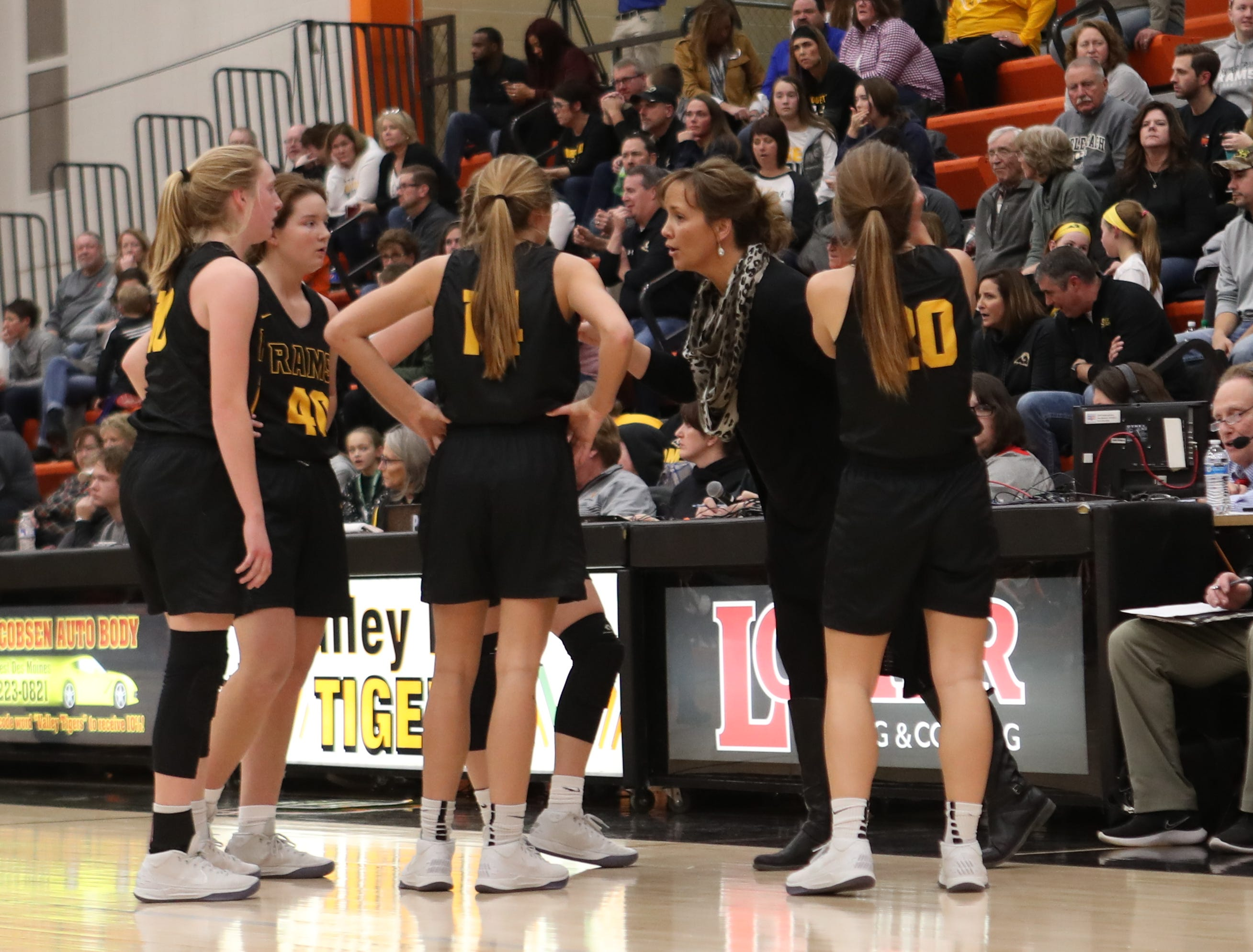 Southeast Polk Rams head coach Tracy Dailey talks to her team during a girls basketball game at Valley High School on Jan. 11, 2019.