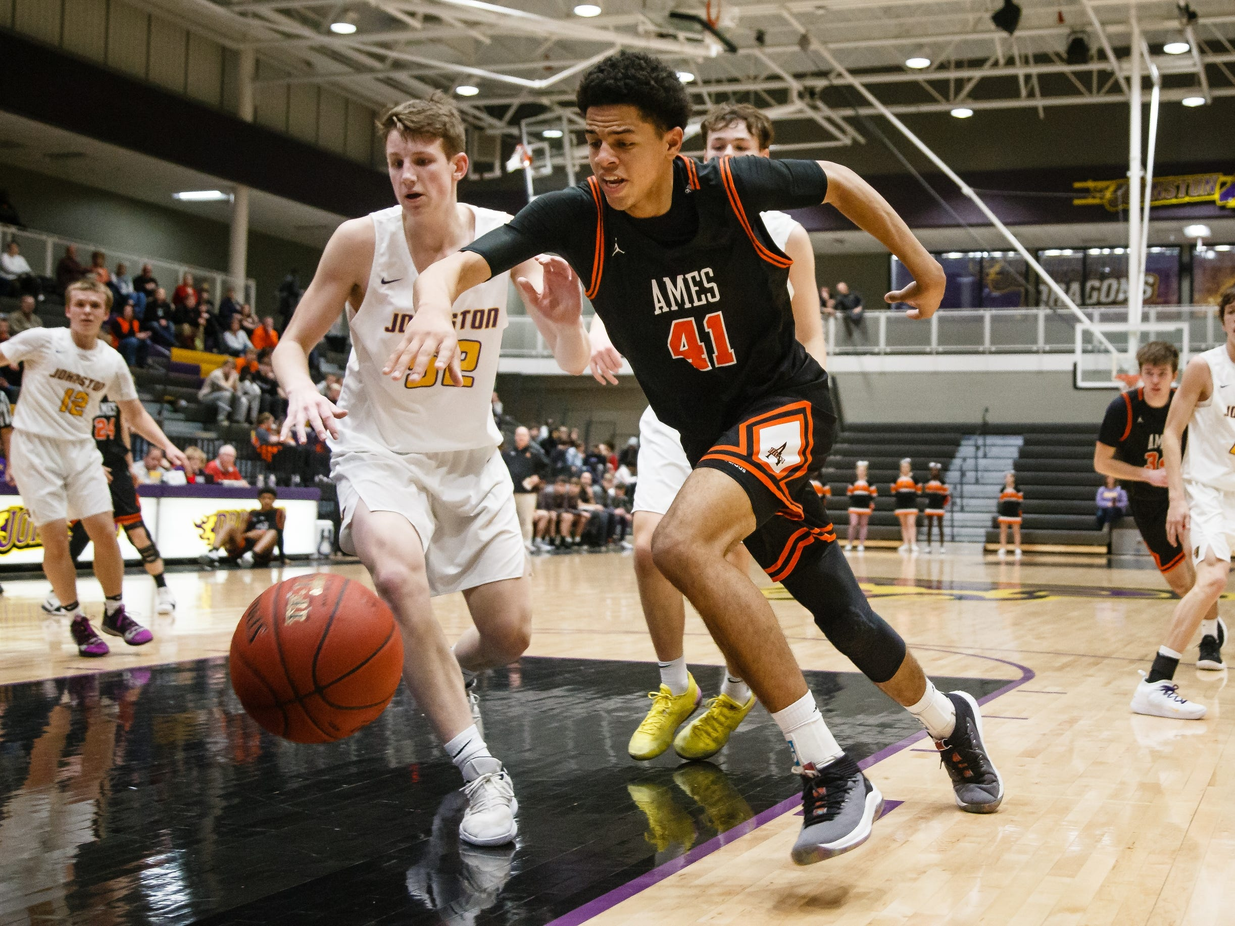 Ames senior Japannah Kellogg chases down a loose ball during Ames' basketball game against Johnston on Friday, Jan. 11, 2019, in Johnston.