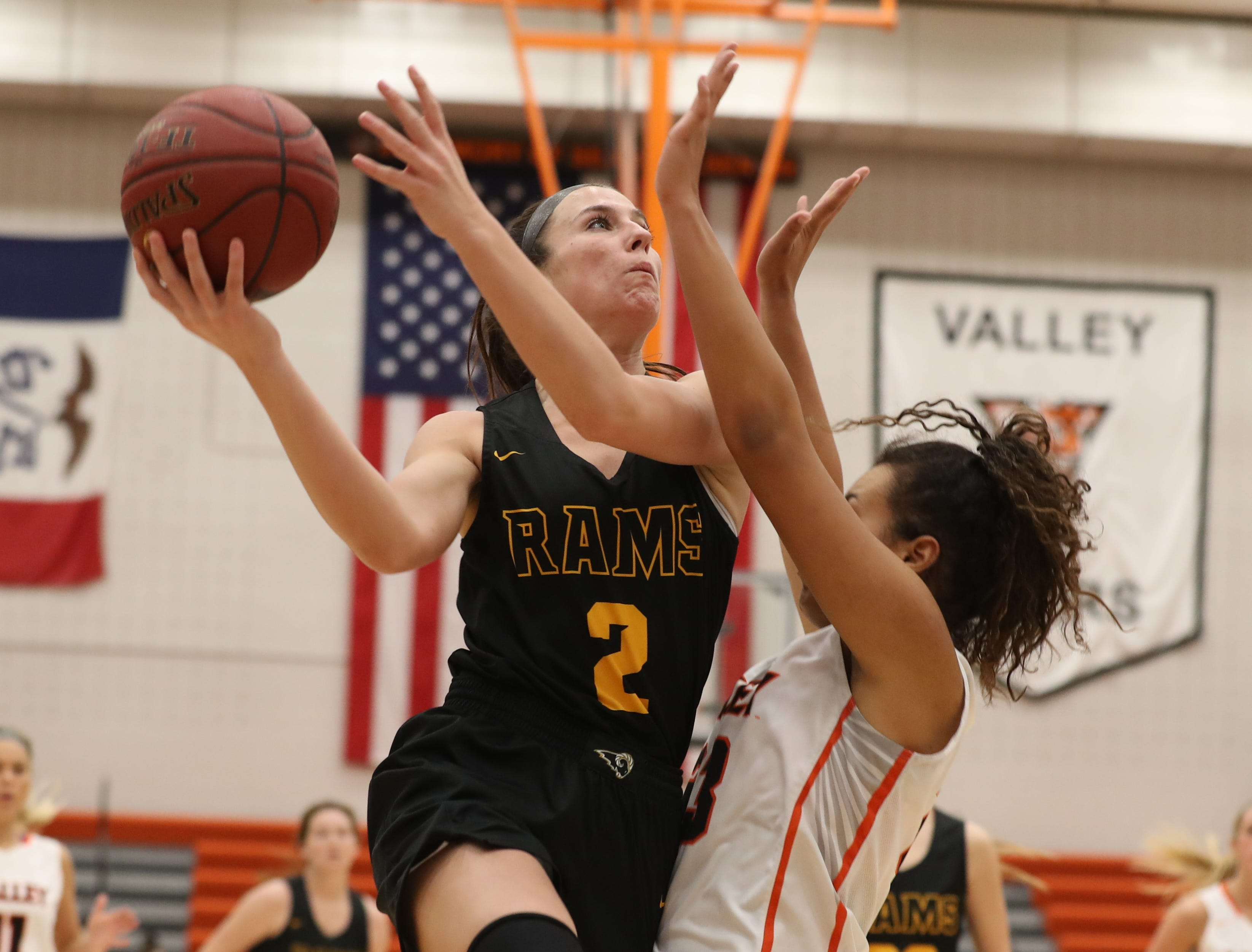 Southeast Polk Rams' Liza Sutten is fouled by Valley Tigers Jasmine Spann during a girls basketball game at Valley High School on Jan. 11, 2019.