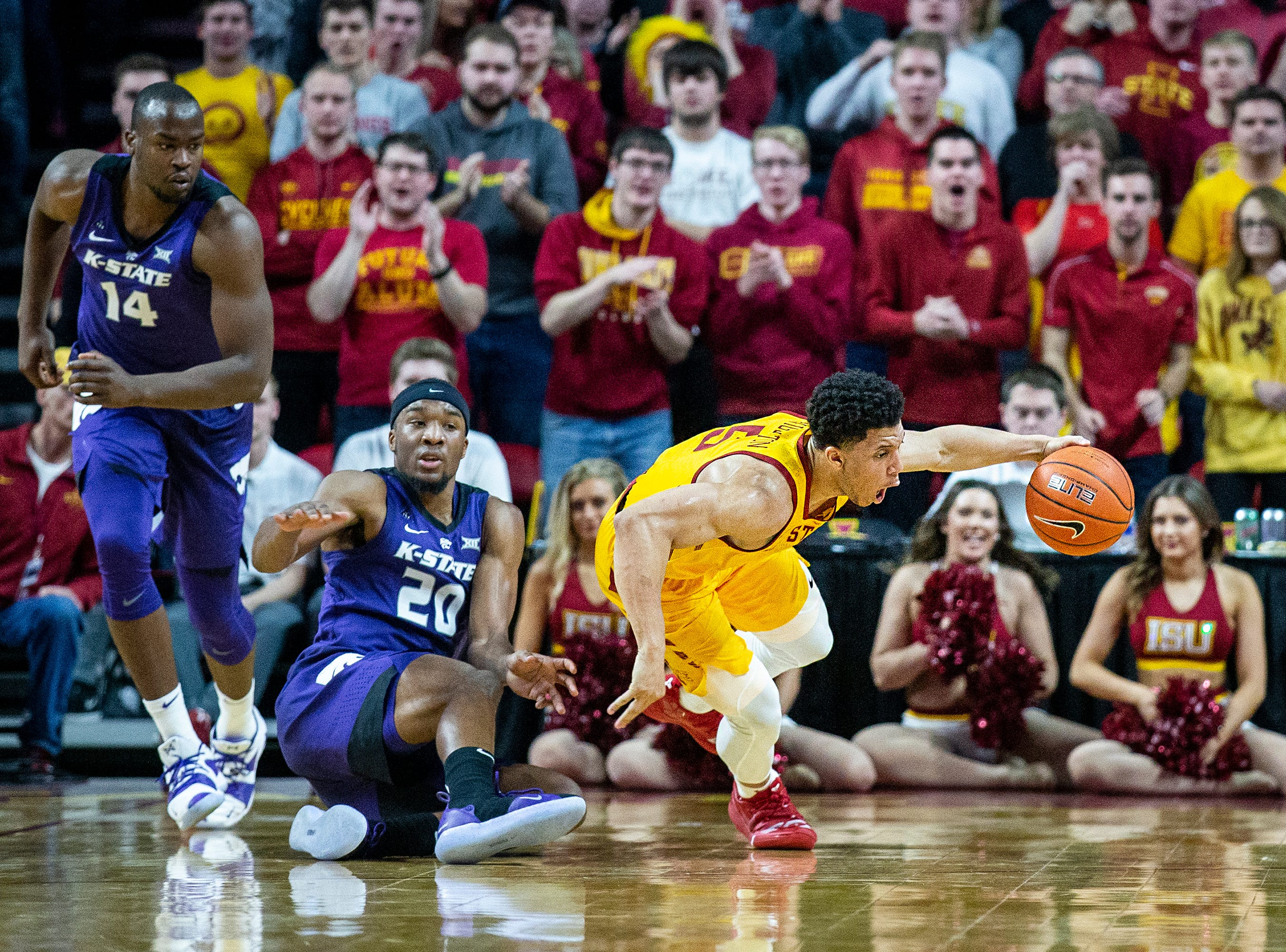Iowa State's Lindell Wigginton tries to hold on to the ball during the Iowa State men's basketball game against Kansas State on Saturday, Jan. 12, 2019, in Hilton Coliseum. The Cyclones lost to KSU by one point, 58-57.