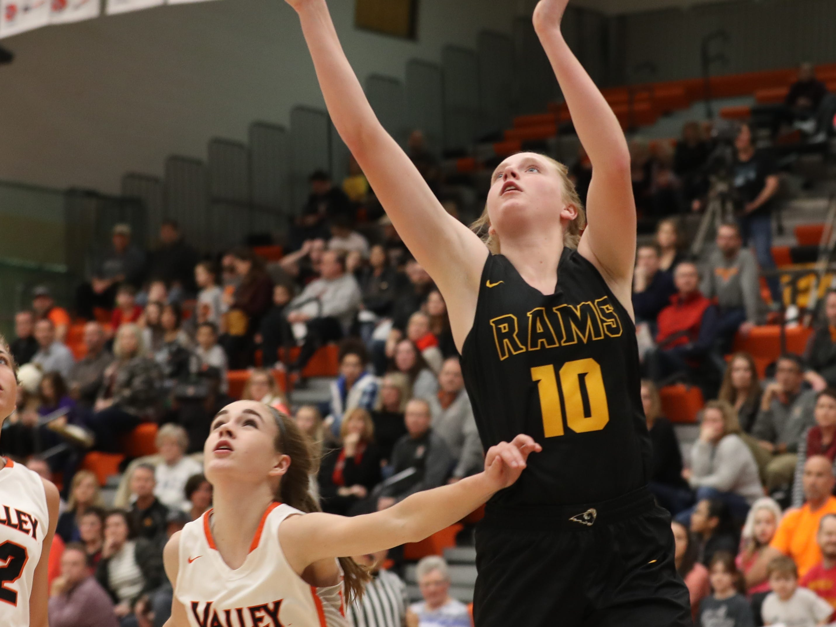 Southeast Polk Rams' Grace Larkins beats Valley Tigers' Hayley Chappell during a girls basketball game at Valley High School on Jan. 11, 2019.