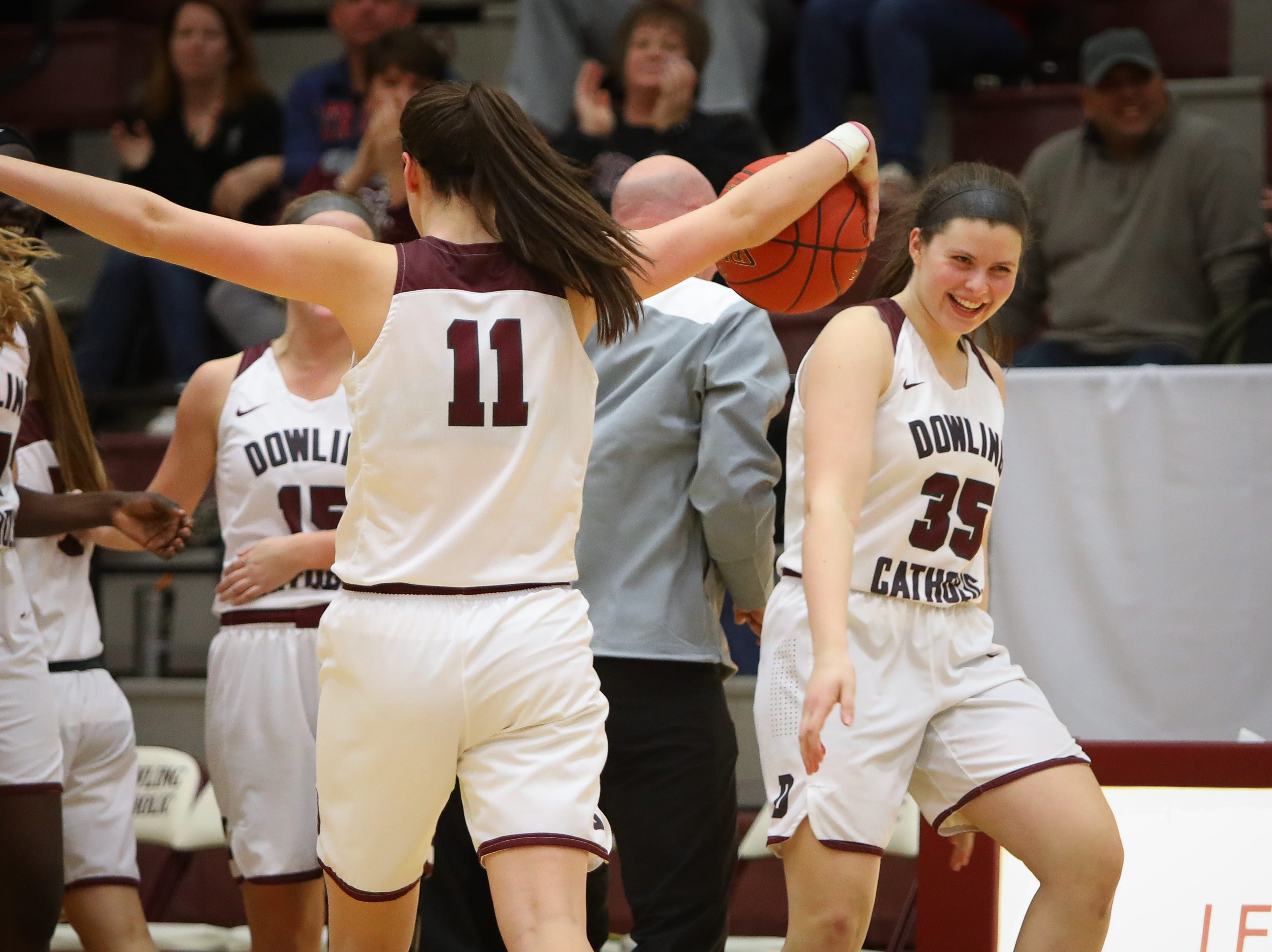 Dowling junior Caitlin Clark (#11) celebrates with senior Jacey Koethe after the Maroons defeated the J-Hawks, 73-71, in a girls high school basketball game between Urbandale and Dowling at Dowling Catholic High School on Jan. 11, 2019 in West Des Moines, Iowa. Clark scored 46 points in the game.