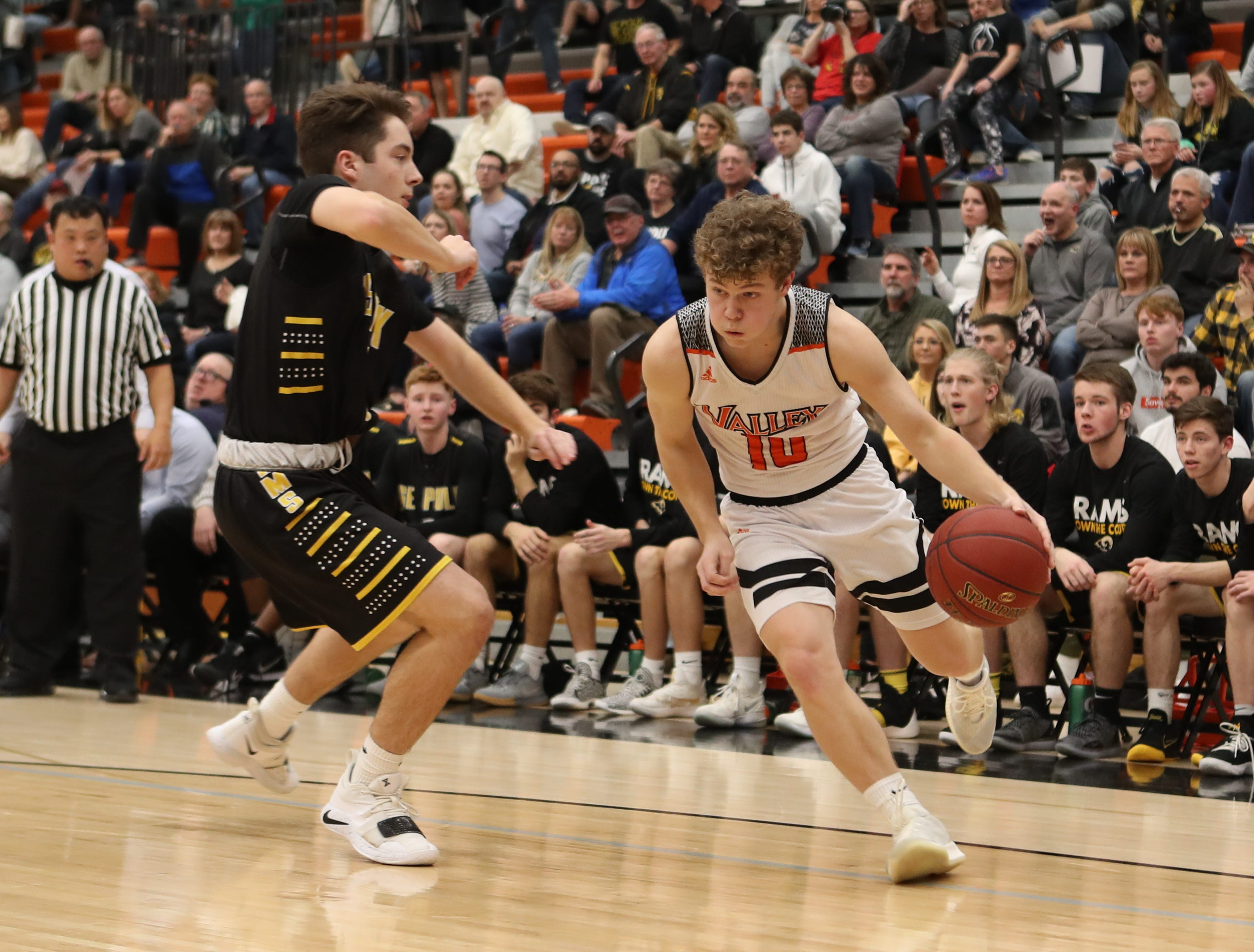 Valley Tigers' Sam Stevens (10) drives baseline against the Southeast Polk Rams during a boys basketball game at Valley High School on Jan. 11, 2019.