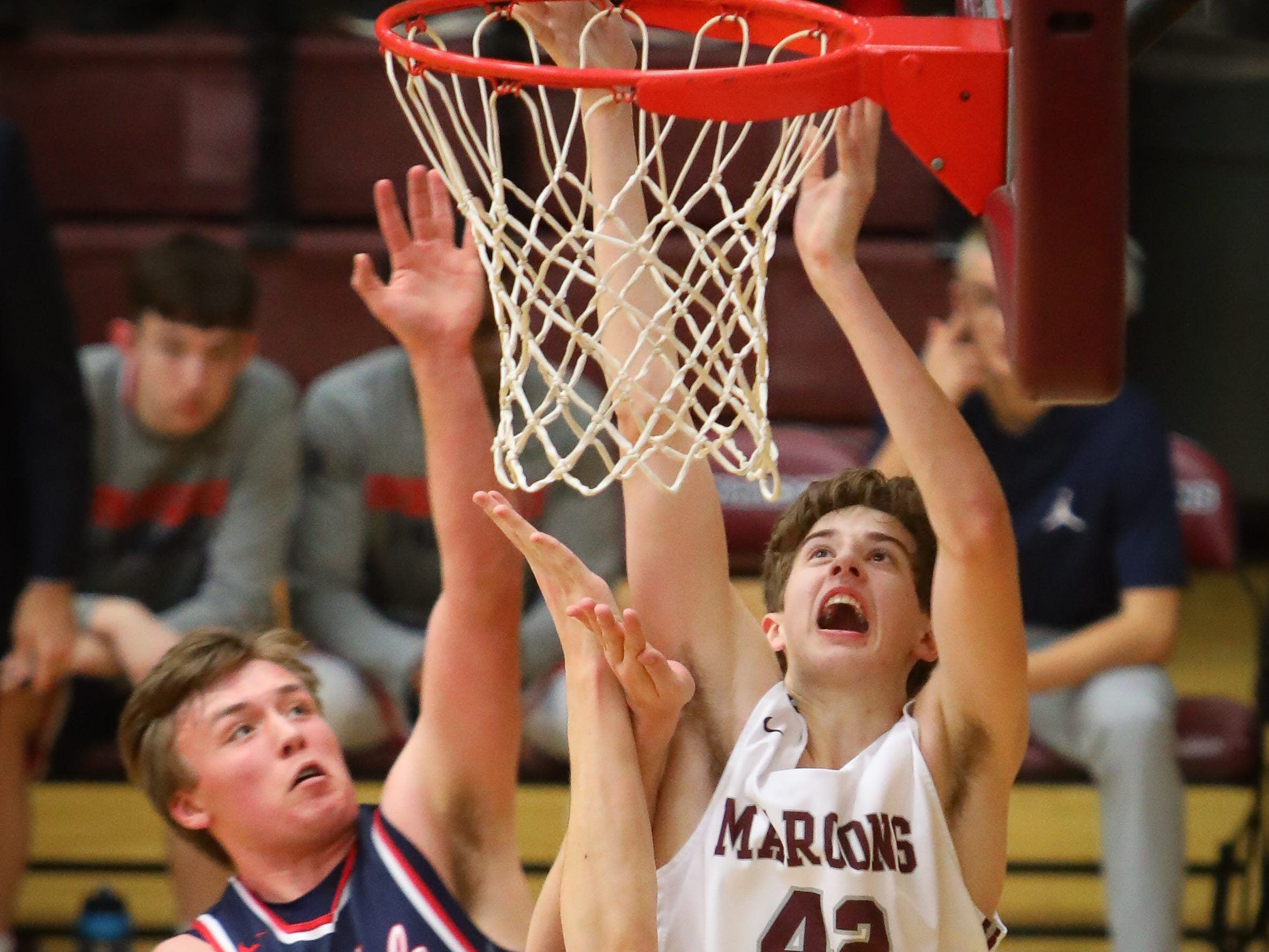 Dowling junior Drew Daniel tips the ball into the basket during a boys high school basketball game between the Urbandale J-Hawks and the Dowling Catholic Maroons at Dowling Catholic High School on Jan. 11, 2019 in West Des Moines, Iowa.