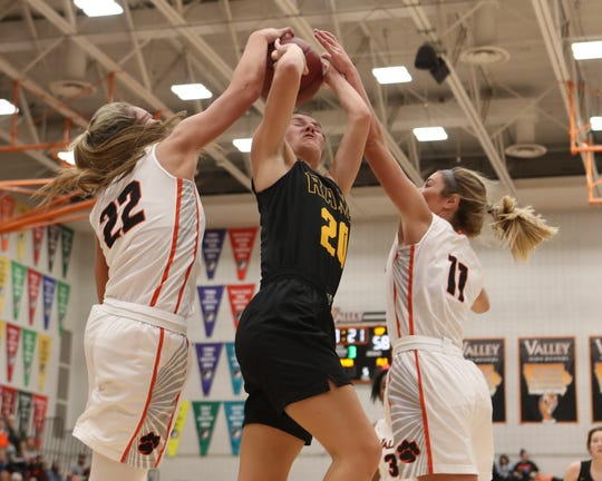 Valley Tigers' Alex Honnold (22) and Shea Fuller (11) close the lane on Southeast Polk Rams' Sami Albertson during a girls basketball game at Valley High School on Jan. 11, 2019.