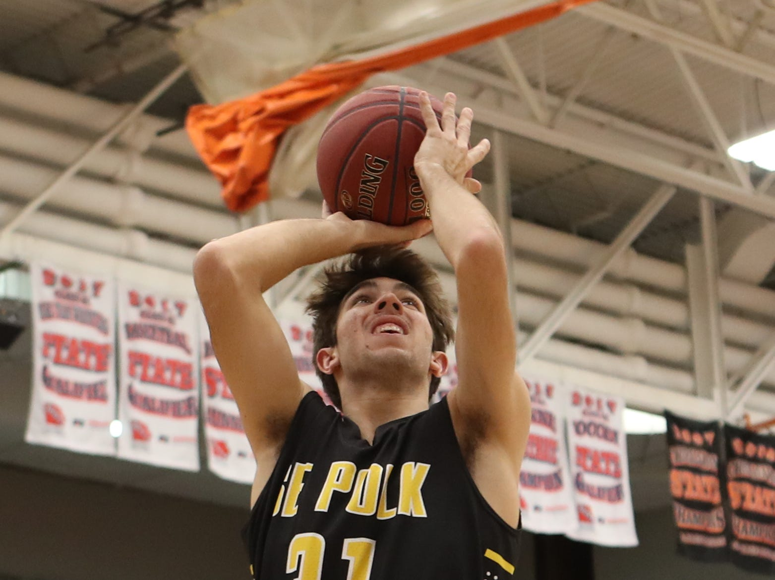 Southeast Polk Rams' Josiah Cole (31) shoots against the Valley Tigers during a boys basketball game at Valley High School on Jan. 11, 2019.