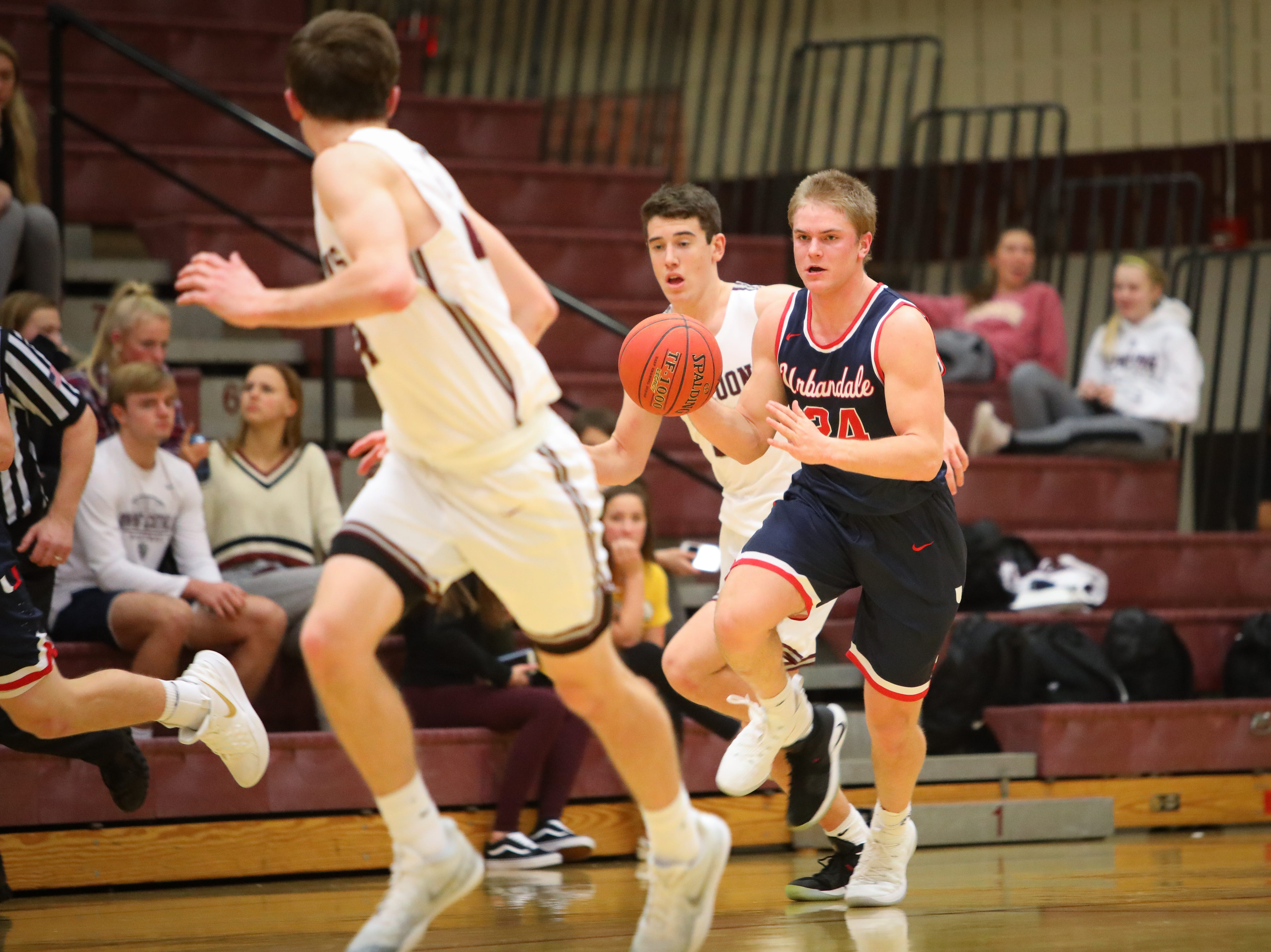 Urbandale senior Will Pattison brings the ball up the court past Dowling during a boys high school basketball game between the Urbandale J-Hawks and the Dowling Catholic Maroons at Dowling Catholic High School on Jan. 11, 2019 in West Des Moines, Iowa.
