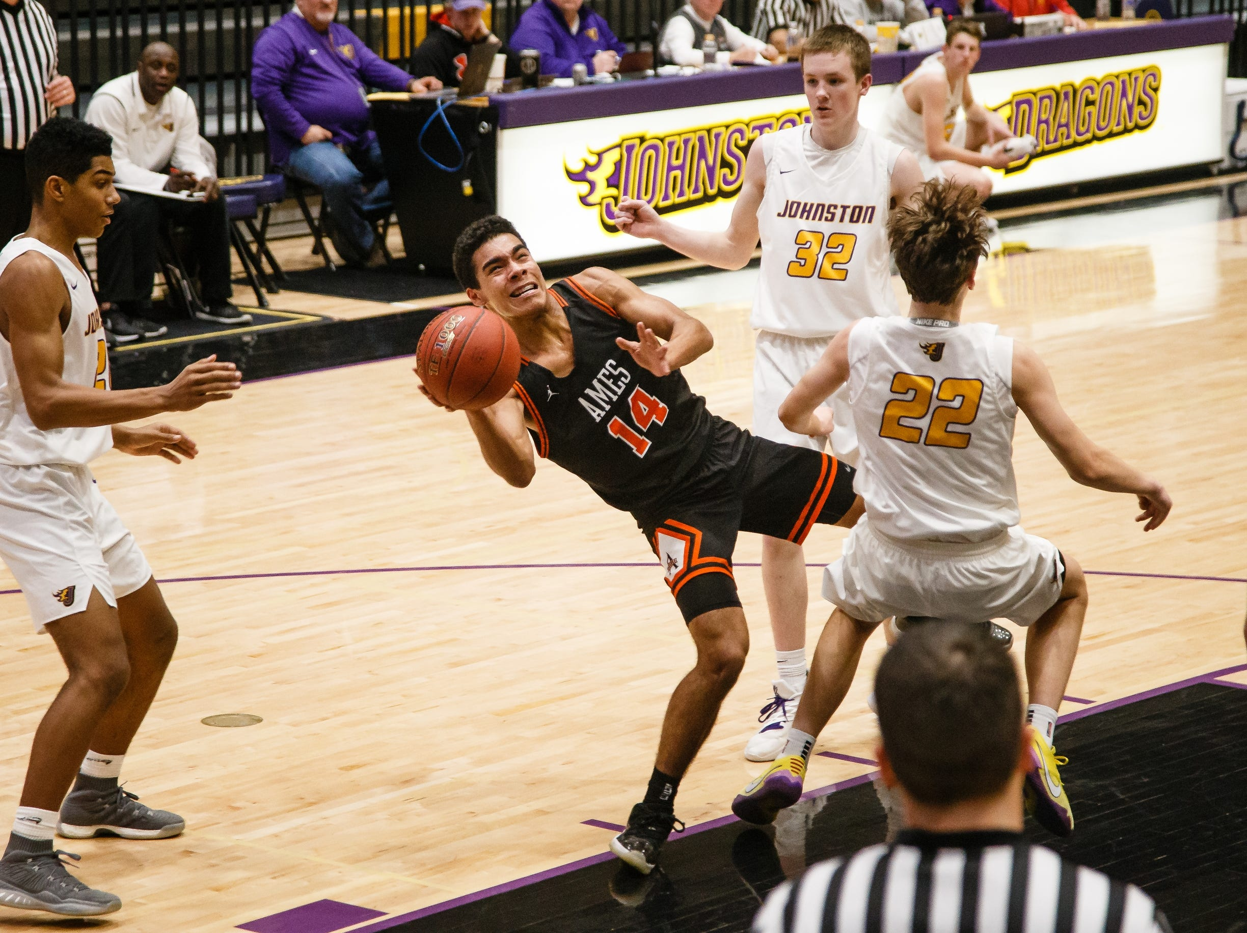 Ames freshman Tamin Lipsey is fouled while shooting during Ames' basketball game against Johnston on Friday, Jan. 11, 2019, in Johnston.