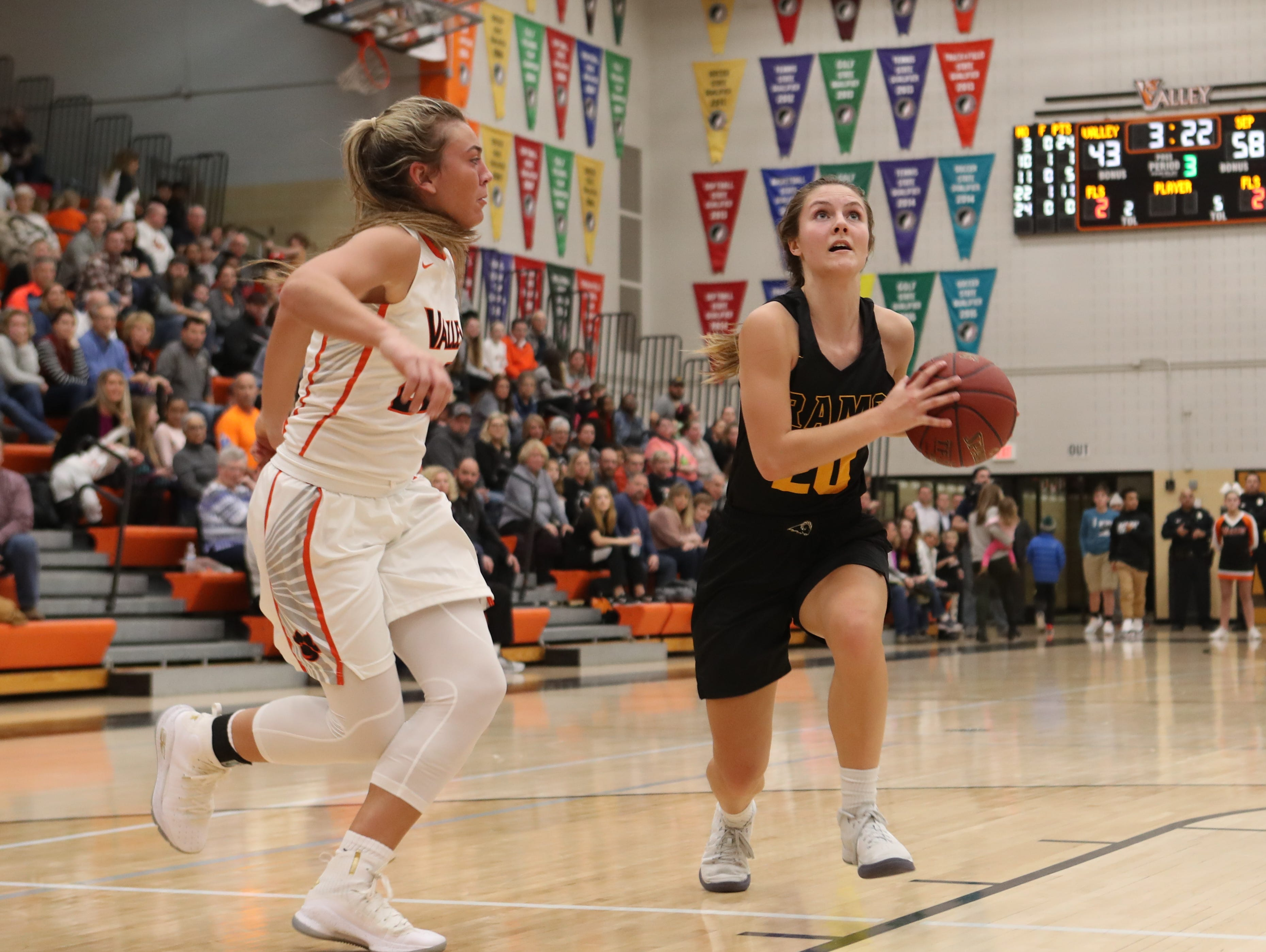 Valley Tigers' Alex Honnold (22) defends Southeast Polk Rams' Sami Albertson during a girls basketball game at Valley High School on Jan. 11, 2019.