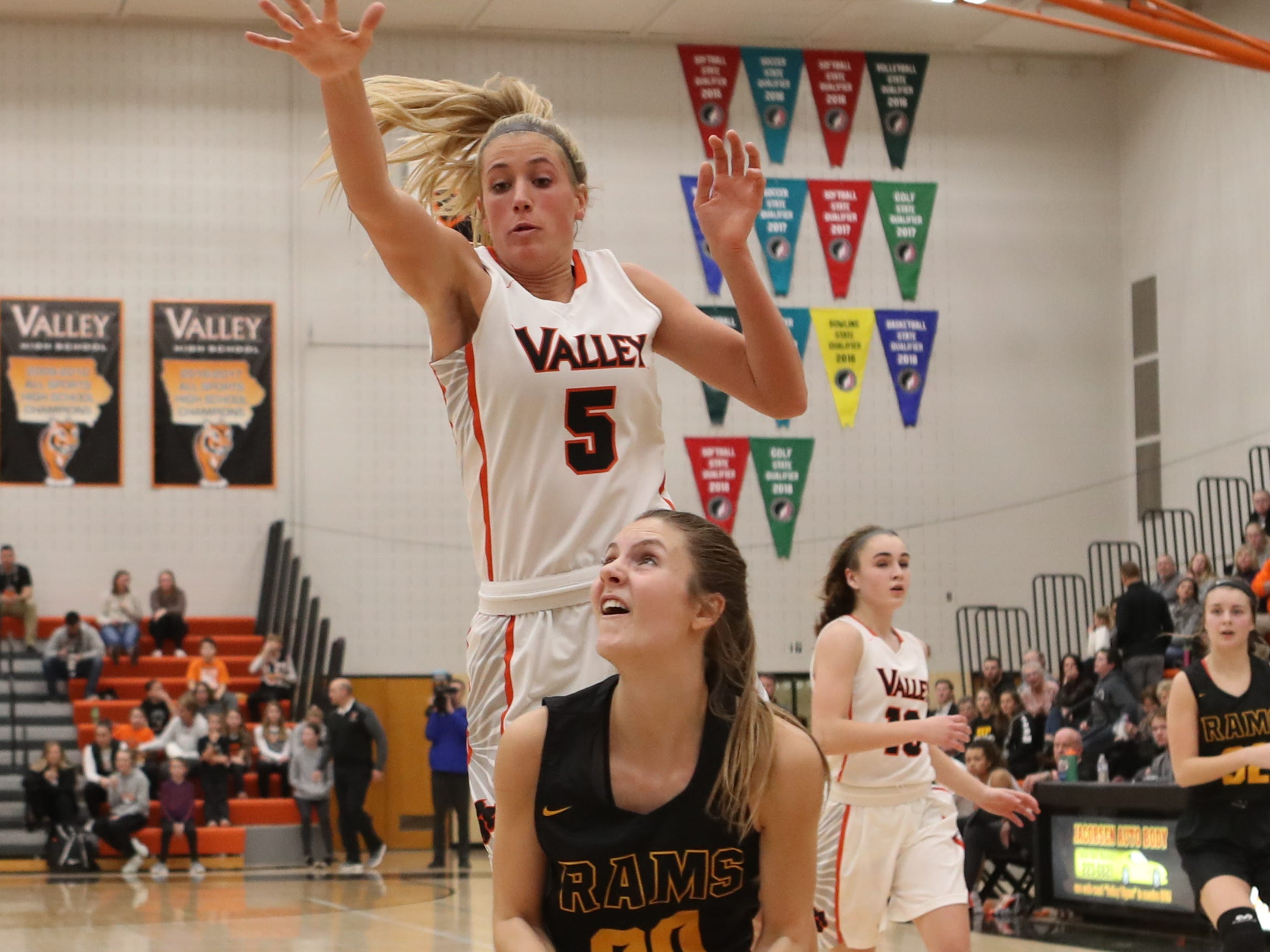 Valley Tigers' Grace Plummer (5) fouls Southeast Polk Rams' Sami Albertson during a girls basketball game at Valley High School on Jan. 11, 2019.