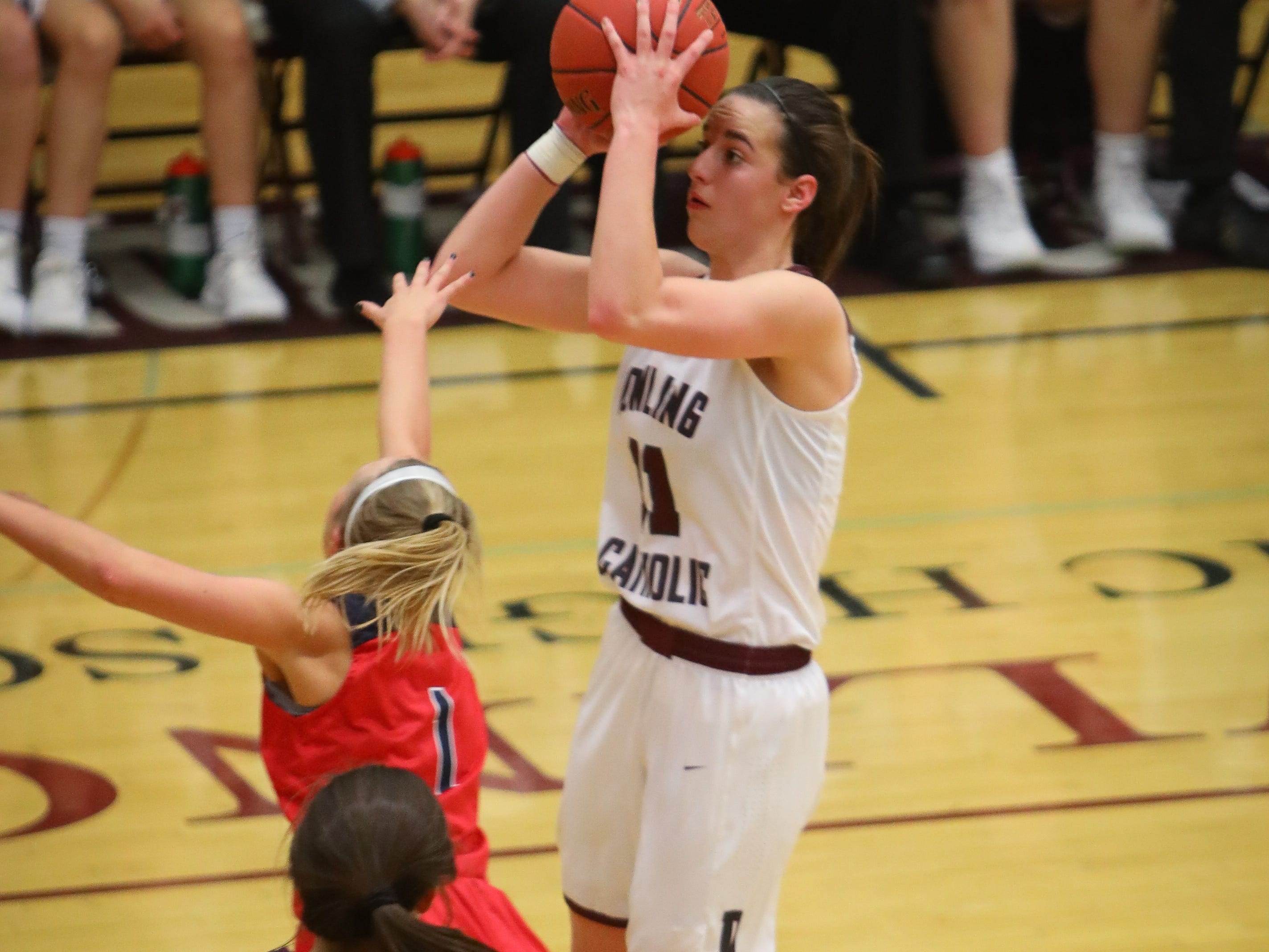 Dowling junior Caitlin Clark drains a jump shot during a girls high school basketball game between the Urbandale J-Hawks and the Dowling Catholic Maroons at Dowling Catholic High School on Jan. 11, 2019 in West Des Moines, Iowa. Clark went on to score 46 points in the game.