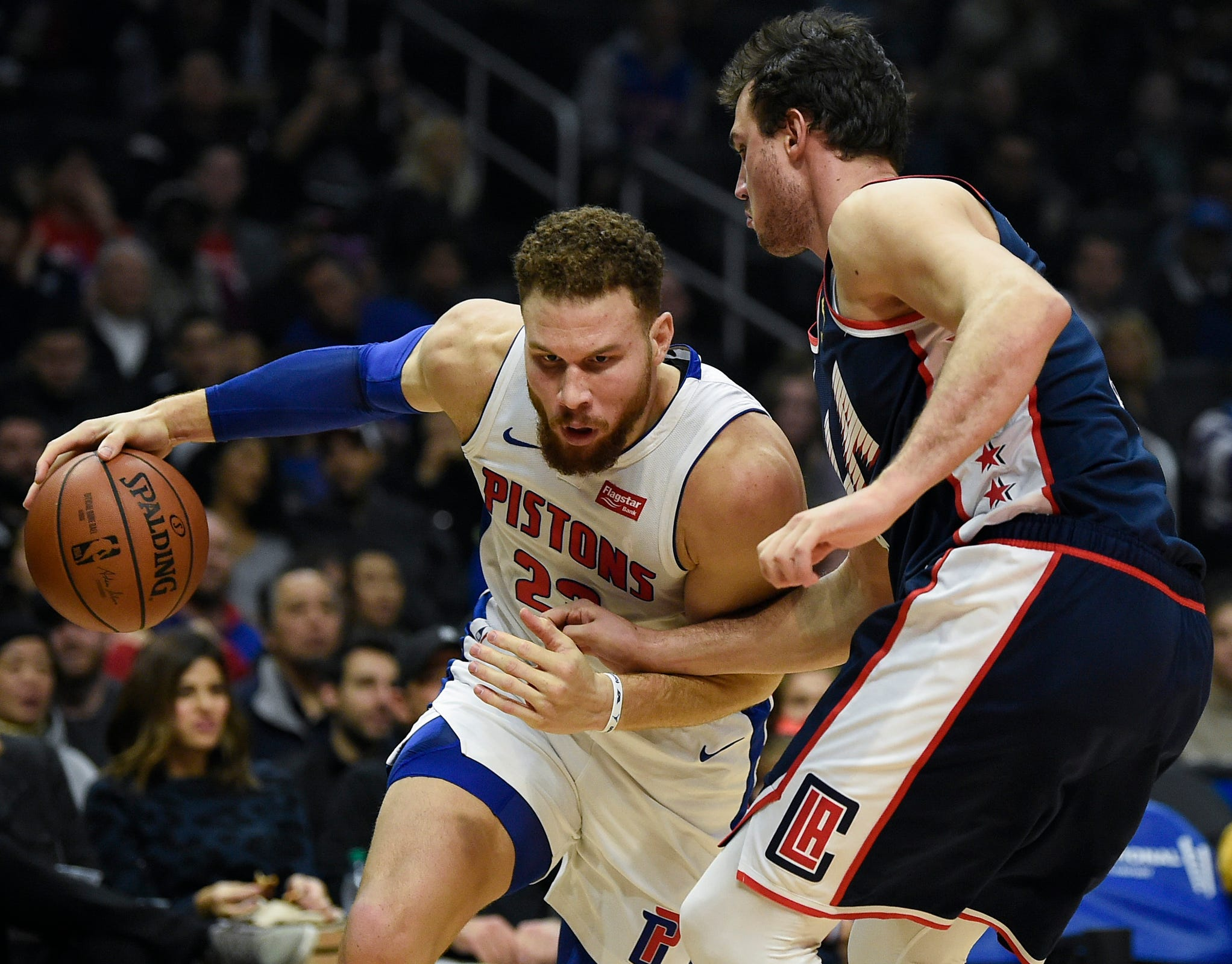 Blake Griffin drives to the basket defended by Clippers forward Danilo Gallinari.
