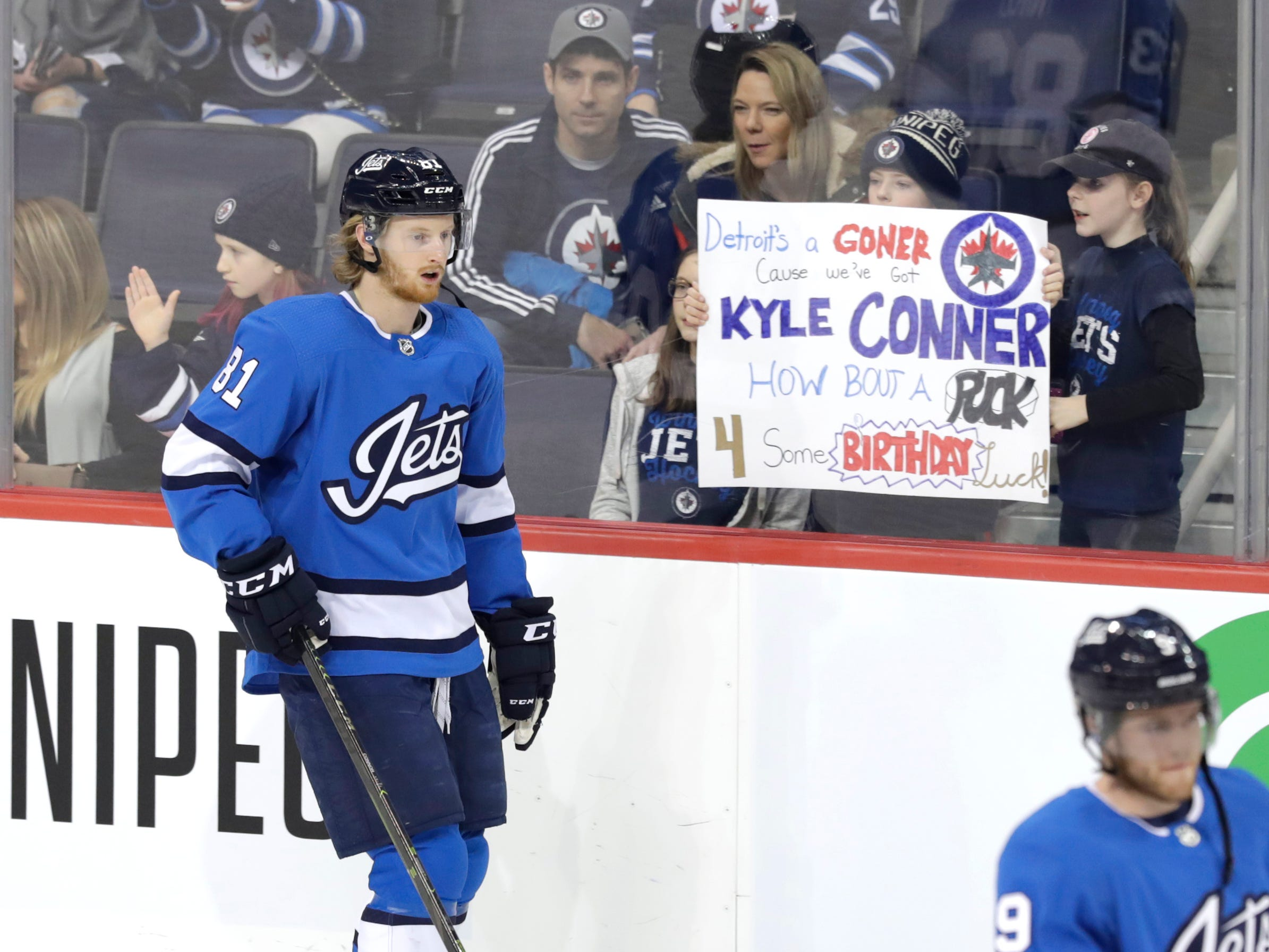 Winnipeg Jets left wing Kyle Connor skates past fans before a game against the Detroit Red Wings at Bell MTS Place, Jan. 11, 2019 in Winnipeg.