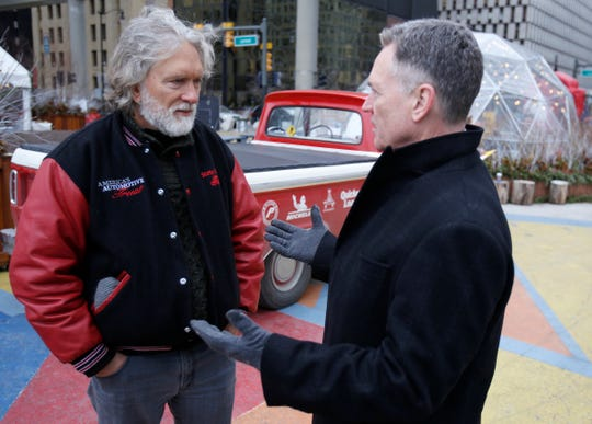 (L to R) America's Automotive Trust Vice Chairman David Madeira and North American International Auto Show executive director Rod Alberts talk before their press conference about The Drive Home caravan that stopped at Spirit of Detroit Plaza in downtown Detroit on January, 12, 2019.