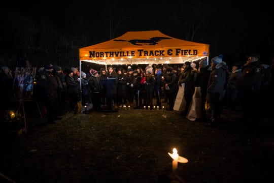 Northville community come together for a candlelight vigil to remember the Abbas family at the Ford Field Park in Northville Friday, Jan. 11, 2019.