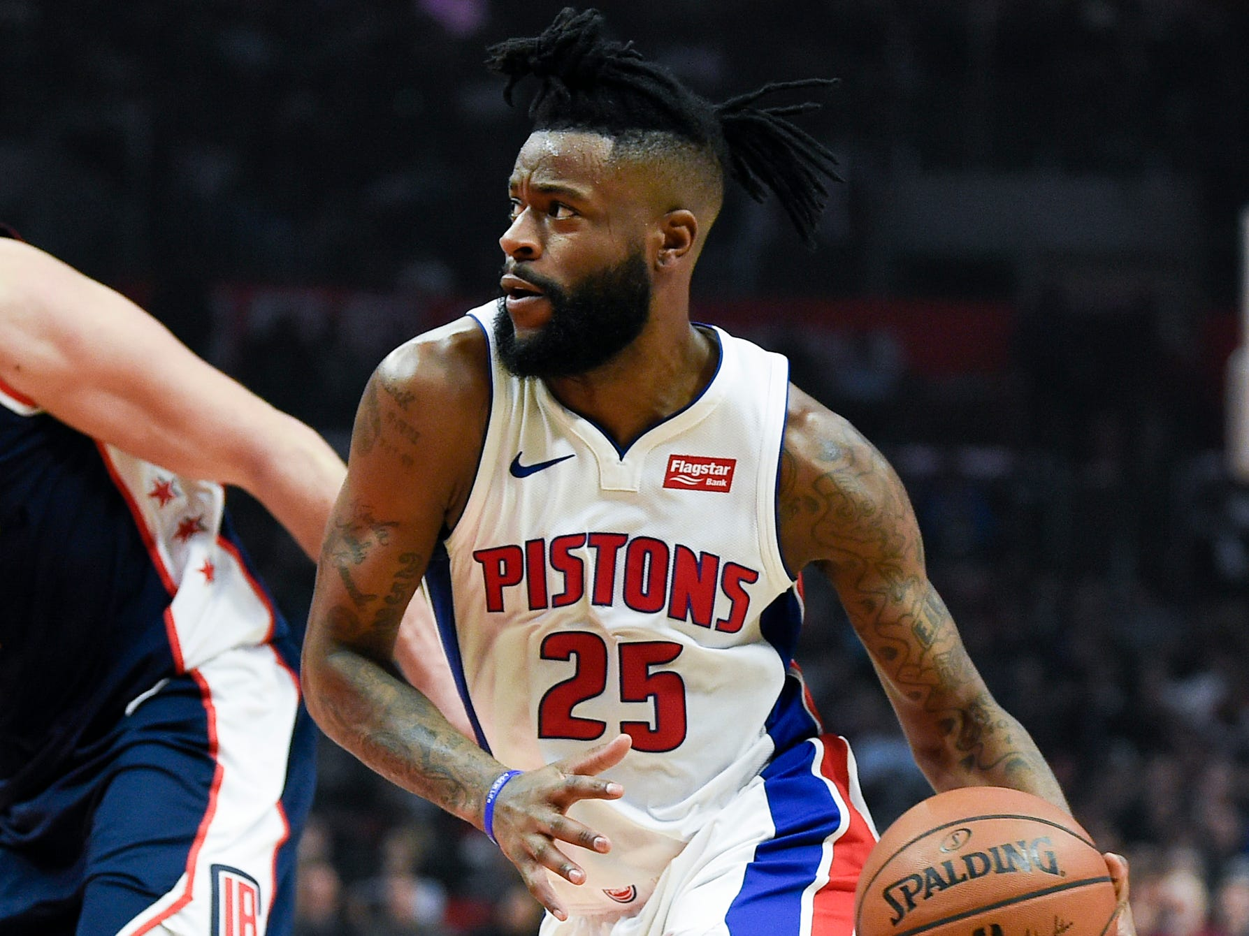 Pistons guard Reggie Bullock drives to the basket ahead of Clippers forward Danilo Gallinari during the first half on Jan. 12, 2019, in Los Angeles.