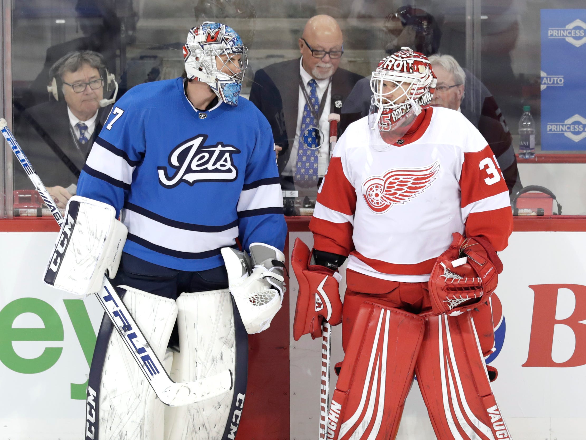 Winnipeg Jets goaltender Connor Hellebuyck talks with Detroit Red Wings goaltender Jimmy Howard during warmups at Bell MTS Place, Jan. 11, 2019 in Winnipeg, Manitoba, CAN.