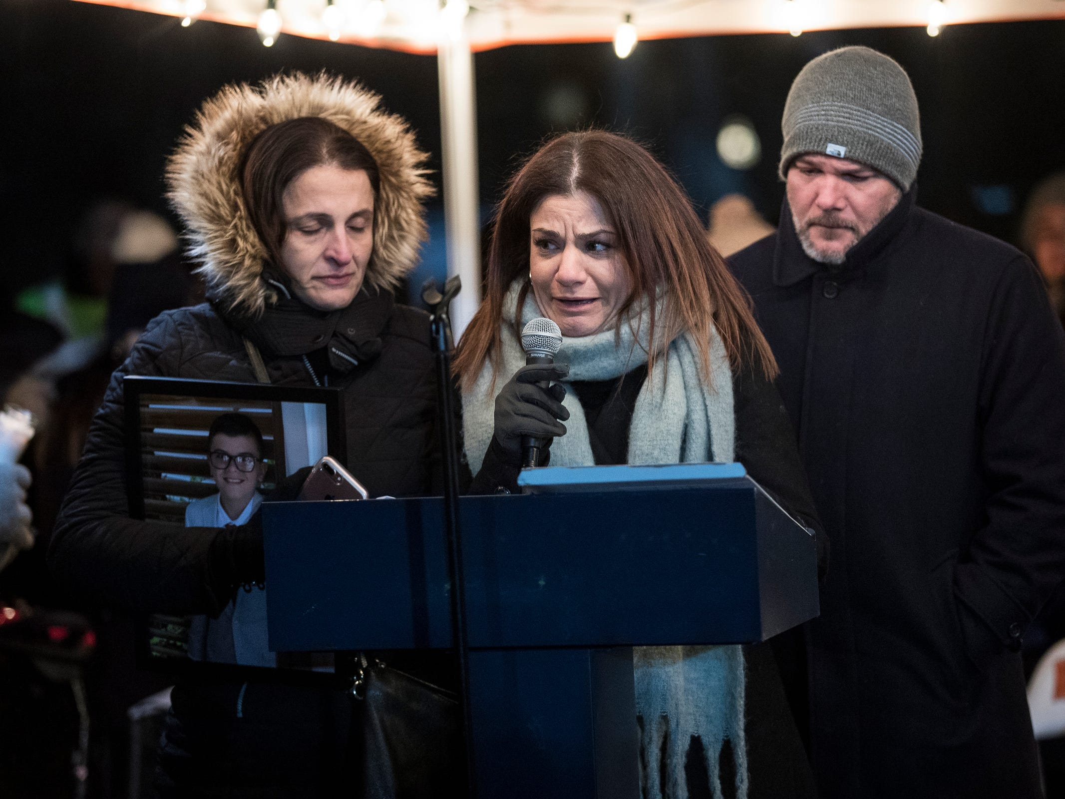 Rima Abbas' sister Rana Abbas Taylor, center, speaks during a candlelight vigil for the Abbas family at the Ford Field Park in Northville Friday, Jan. 11, 2019.