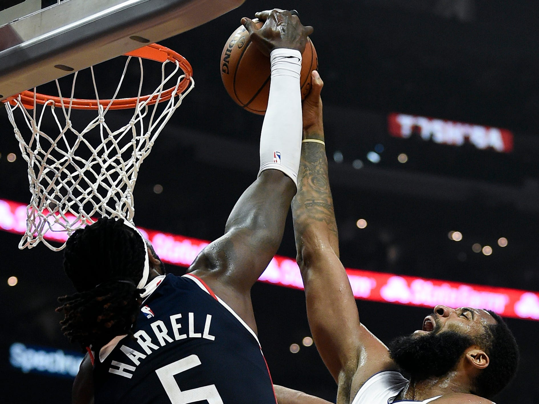 Clippers forward Montrezl Harrell blocks a shot by Pistons center Andre Drummond during the first half on Jan. 12, 2019, in Los Angeles.