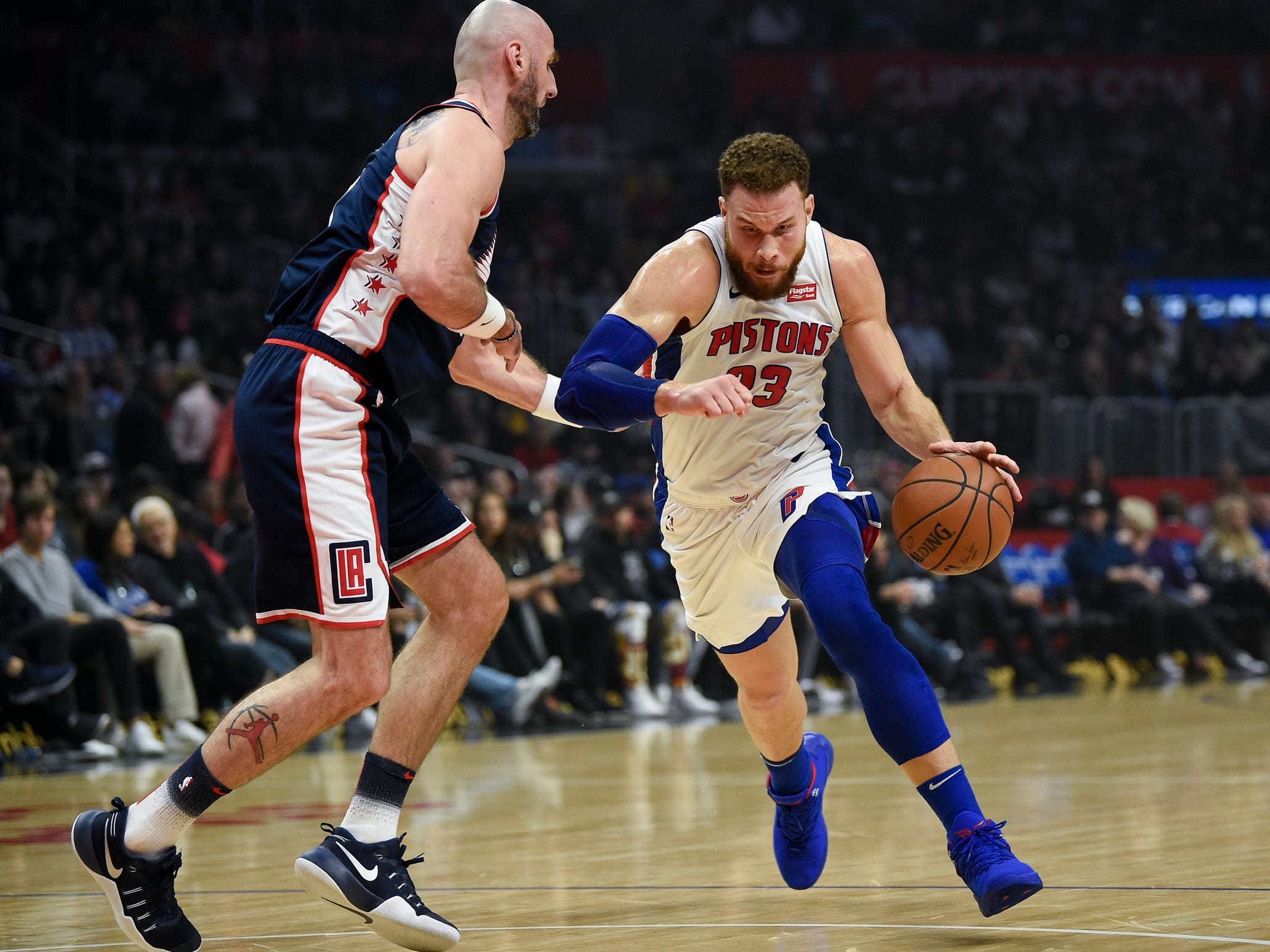 Pistons forward Blake Griffin drives to the basket while Clippers center Marcin Gortat defends during the first quarter on Saturday, Jan. 12, 2019, in Los Angeles.